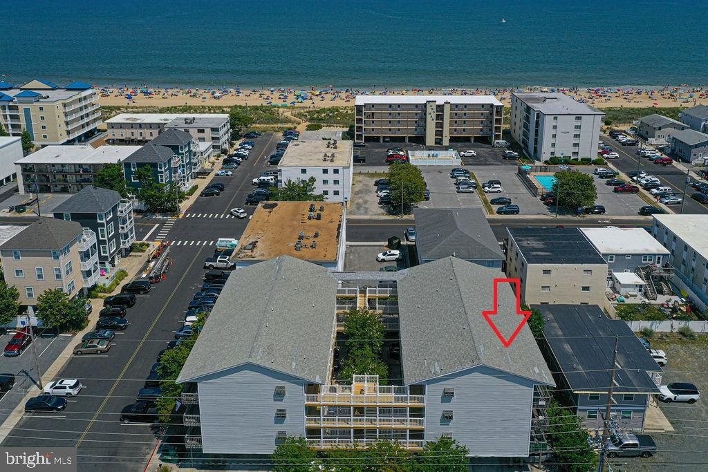 Just reduced! Enjoy a peek at the ocean and bay from the generous balcony of this spacious ocean block condo located in North Ocean City close to the MD/DE line. The unit features open concept living with a kitchen peninsula counter seating, dining area, living room, 2 bedrooms and 2 full bathrooms. Ample storage throughout. Well maintained building and great association. Parking includes 1 assigned space under the building and additional spaces for overflow parking that is shared on a first come first serve basis. Located close to restaurants, mini-golf, shopping, movie theater and Famous Fisher's Popcorn. Directly across the street from Northside Park. The 58 acre Bayfront complex has a fishing lagoon, two playgrounds, picnic area, two piers, a gazebo, walking/jogging paths and much more. Sunday evenings in the park include a free concert and fireworks. Watch the fireworks show from the condo on the south facing balcony.