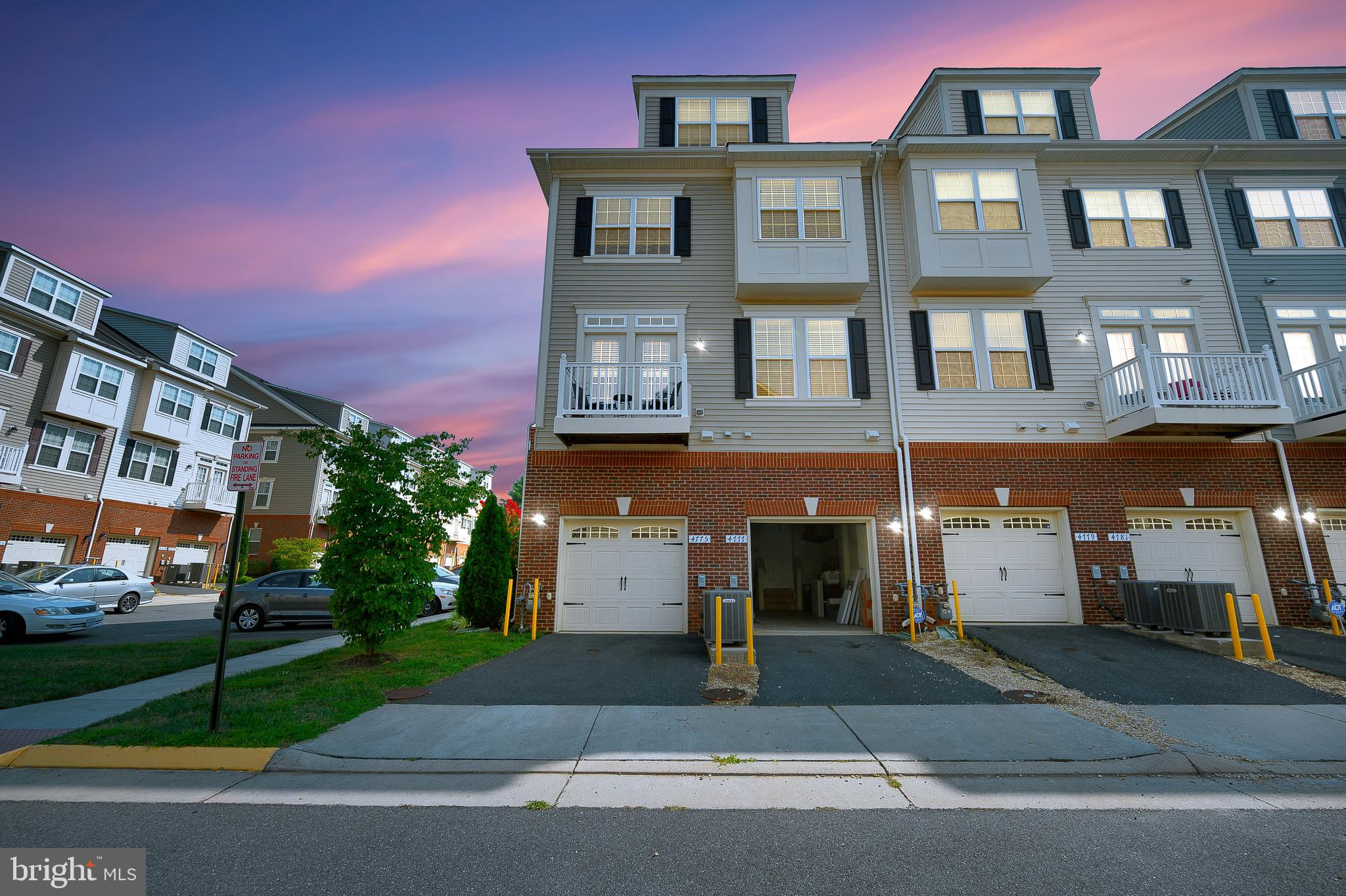 Step inside this lovely brick 4 story End Unit Townhouse with above level 1 car Garage! You will lov