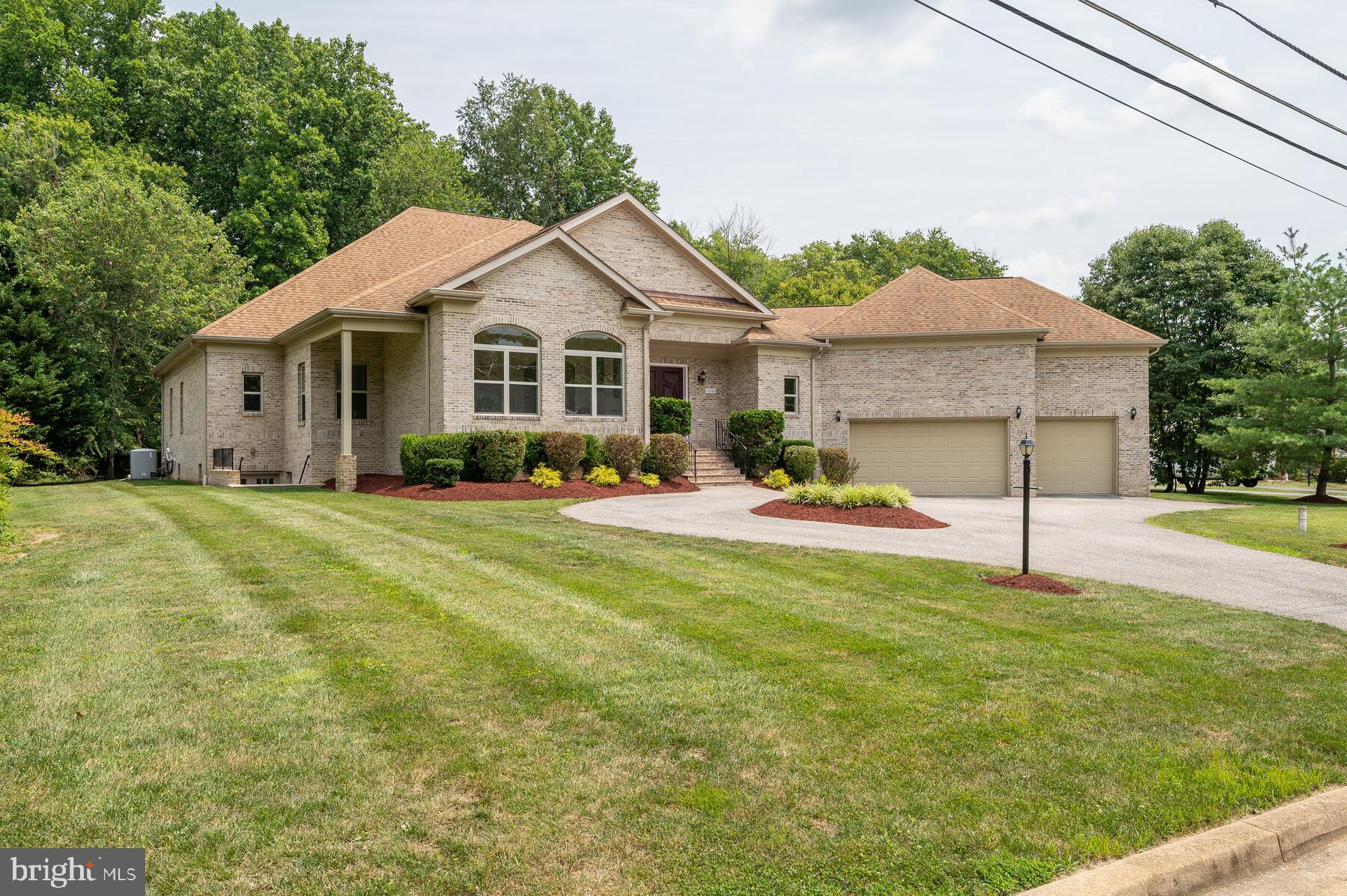 MAGNIFICENT, CUSTOM-BUILT all-brick  Contemporary Home  with a grand front circular drive way , over
