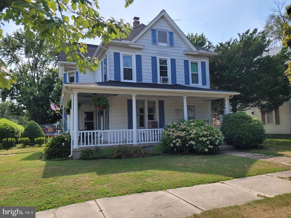 Classic Eastern Shore Victorian with amazing wrap around front porch on a large corner lot.  Fenced