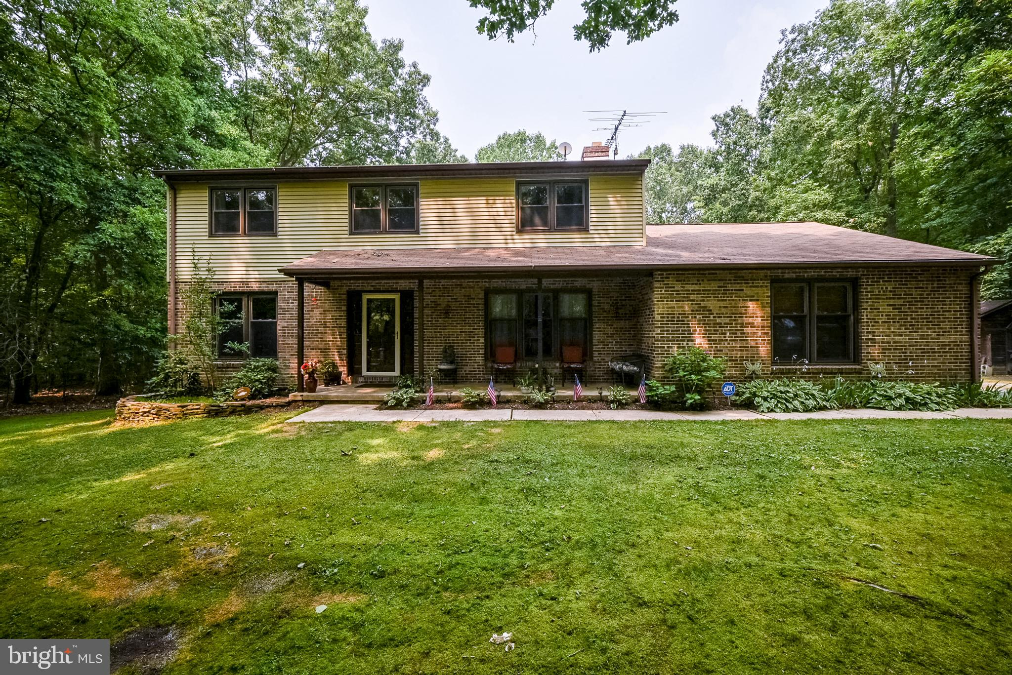 Welcome to 1671 Irishtown Road!  Tucked away on a wooded 5.37 acre lot, just steps away from Elk Nec