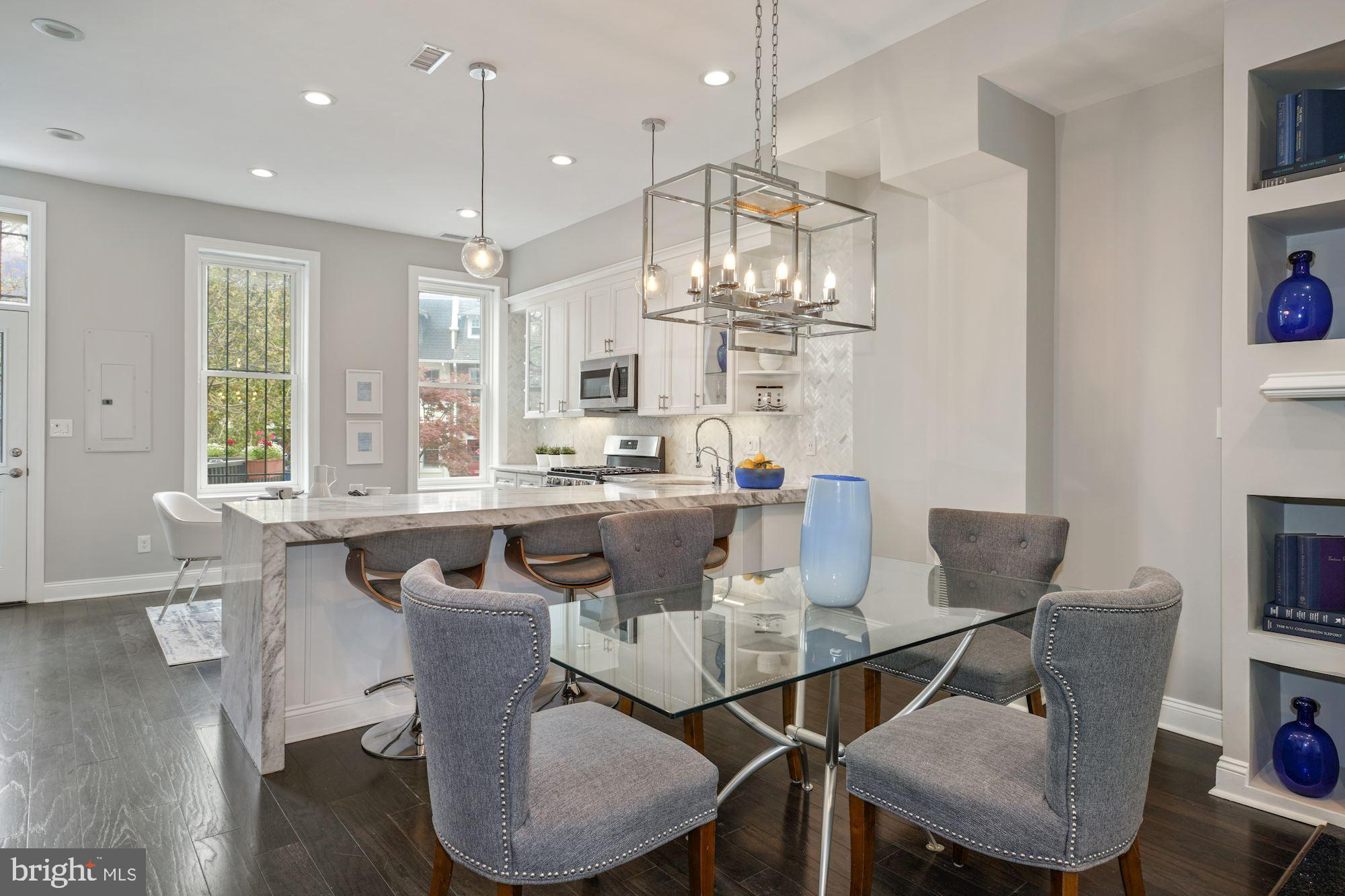 Welcome home to.this Grand Victorian row home situated in an unparalleled location just inches from