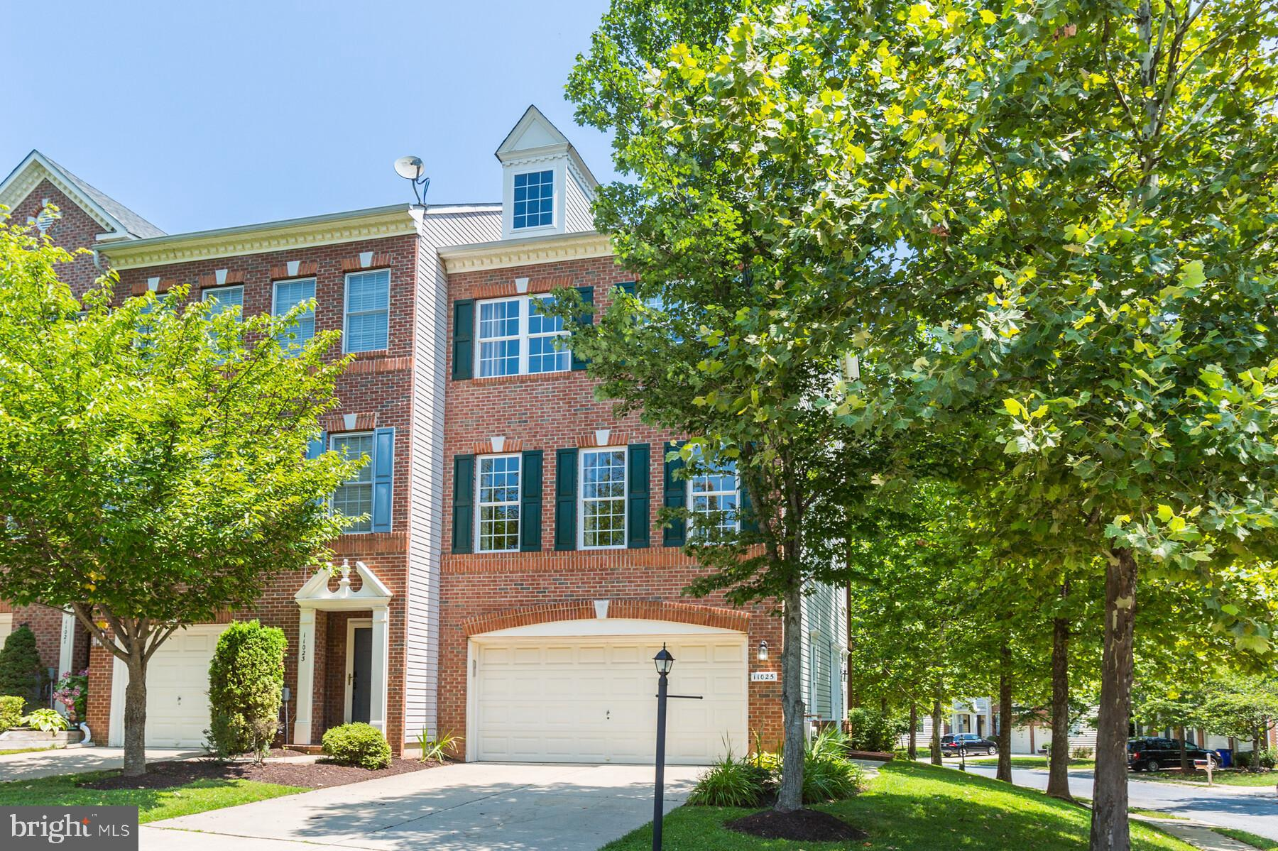 Come see this stunning End Unit Luxury Townhome with 3 finished levels plus 2 car garage in the popu