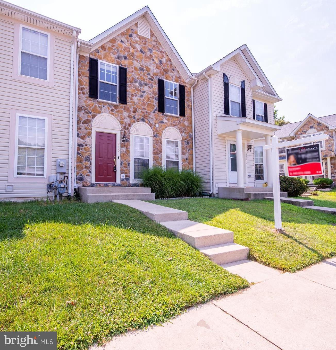 Welcome to this immaculate move-in-ready, stone front townhome. This is not your average townhome! W