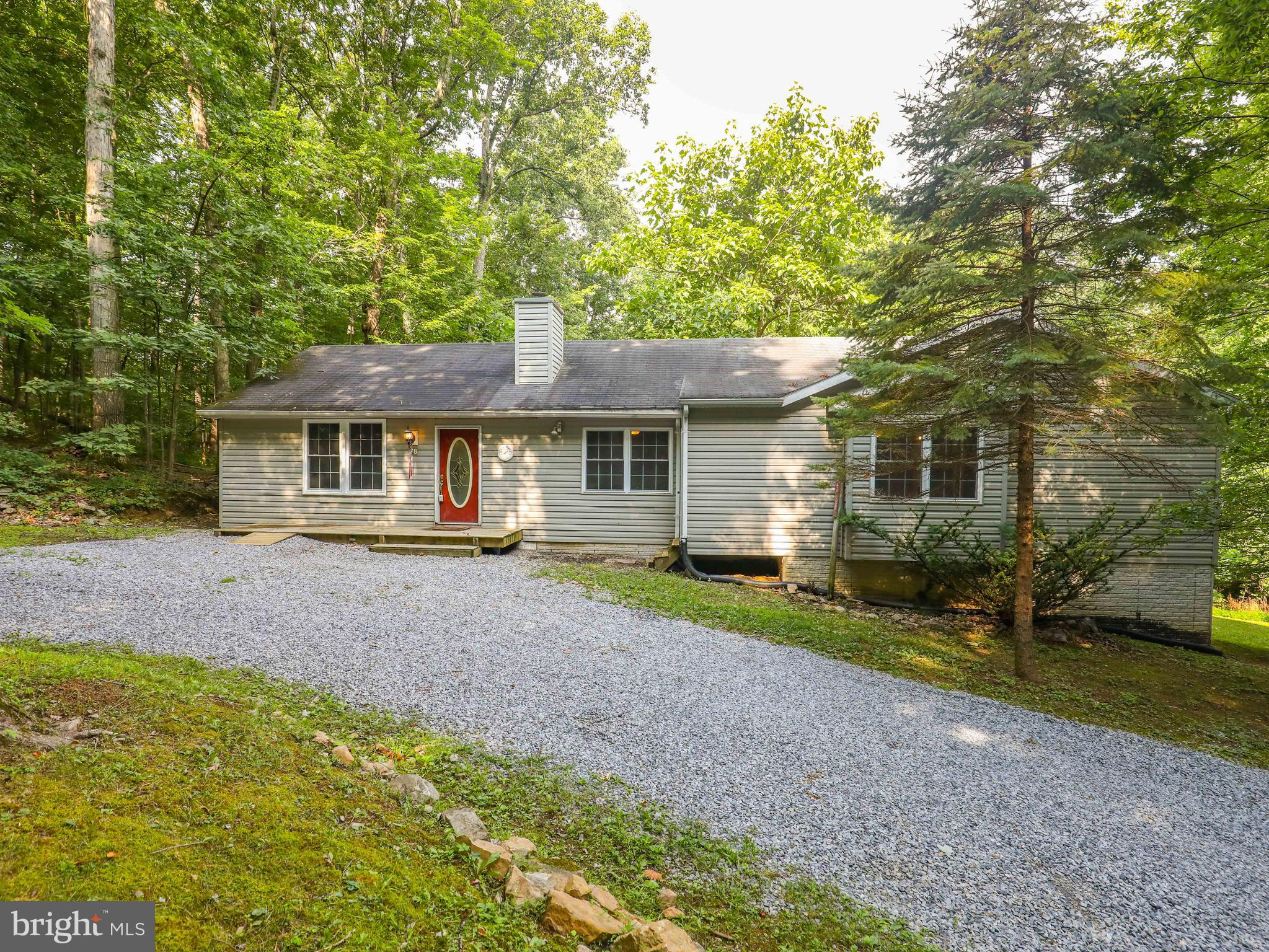 One- story living in privacy and tranquility!  This three-bedroom, three-bath ranch-style home on 2.