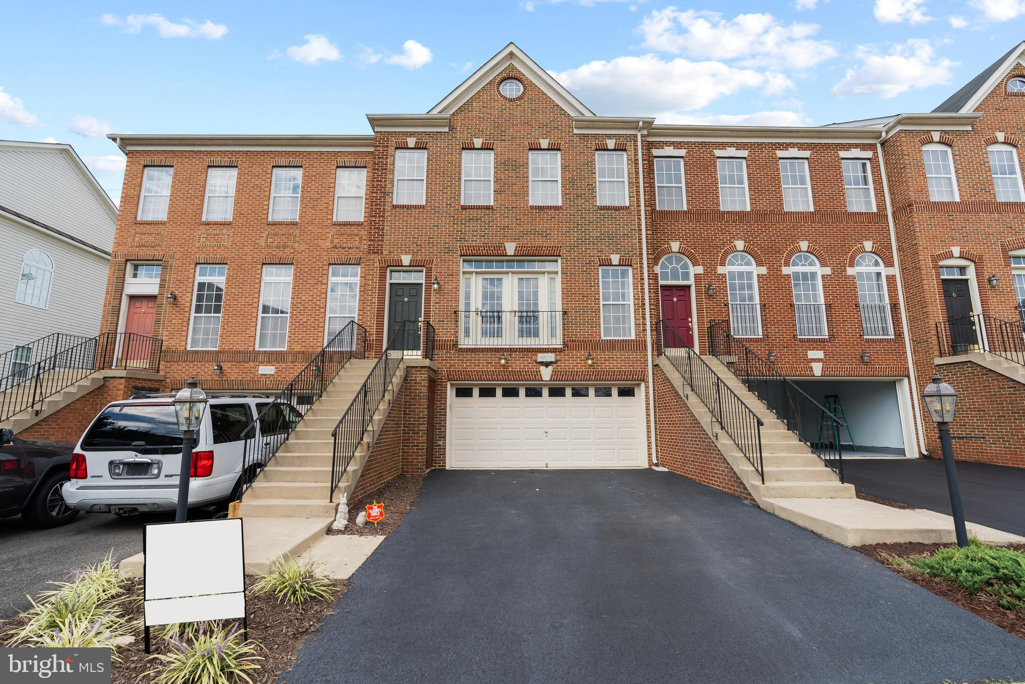 Welcome to 42108 Tanzanite Ter! The 3 bedroom, 3 full bath & 1 half bath garage townhome is located