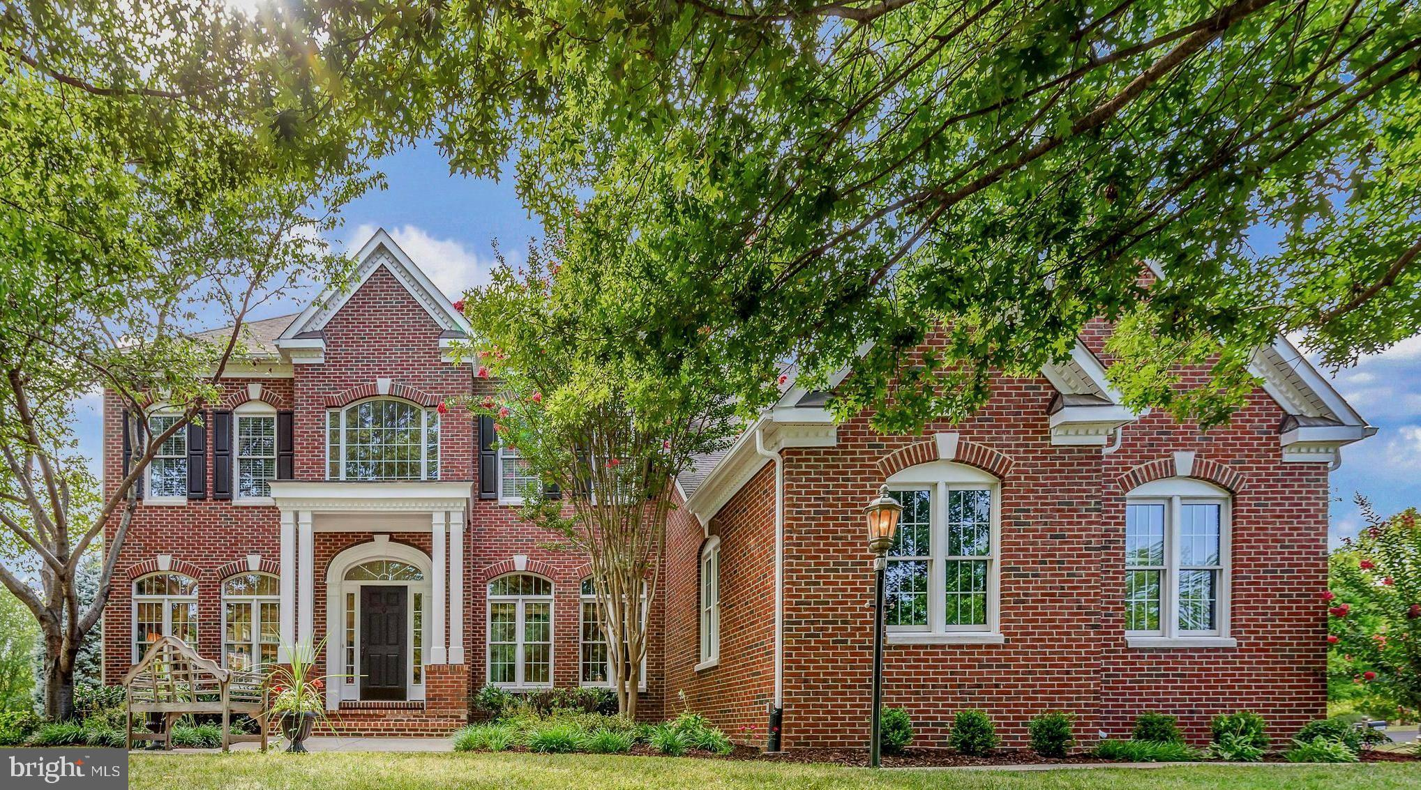 Nestled in the heart of old Ashburn, you'll find this Winchester spec home in the sought after community of Ashburn Station...Builder upgrades throughout!   Step inside this elegant, light filled, and spacious home featuring over 6000 square feet of finished living space on three levels.  The  bright and lightfilled two story foyer opens to a library/office with built-in floor to ceiling maple cabinets/bookshelves, as well as the formal living and dining room, each with floor to ceiling windows.  The dining room leads to a large kitchen, perfect for the family/ chef that likes to cook...featuring a large center island with gas cooktop, beverage station, under the counter and glass cabinet lighting, large walk-in pantry and dining area.  The light filled sunroom is just off of the kitchen which leads to a large deck, perfect for entertaining, relaxing and watching the sunset.  Step into the two story family room adjacent to the kitchen, boasting a  full wall of french doors which also open to the deck area and a two story stone fireplace flanked by additional windows on each side.  A second staircase leads you to the master suite, three large bedrooms with their own bathrooms, as well as a desk/computer station.  The master suite and bathroom are also lightfilled with south and west facing windows.  The master suite features a 10 foot tray ceiling and a walk-in closet.  The spacious masterbath features a large walk-in shower, jacuzzi bathtub and his and her vanities with lots of storage and counterspace.  Two of the bedrooms share a Jack and Jill bathroom.  The 3rd bedroom/ Princess suite features a full bathroom.  The basement area is over 1600 finished square feet featuring walk-up stairs to the side yard, a large family room area, billiards area, wet bar, exercise room, project room, office/guestroom with a walk-in closet and attached full bath,  2 extra large closets, and an unfinished storage room with a full workbench.  The 3 car side load garage features built