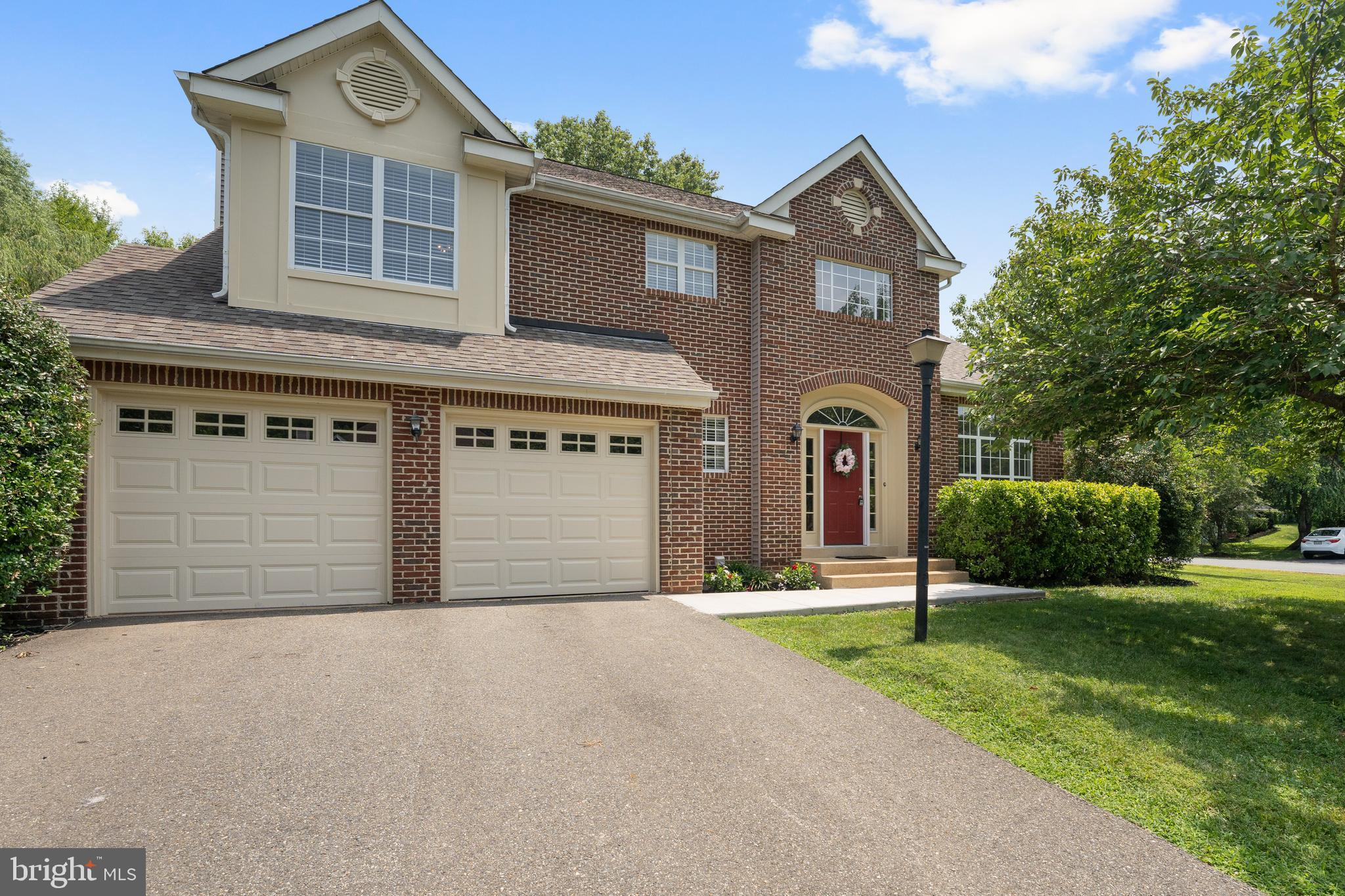 Amazing location, beautiful home!  This brick-front home is located on a large, corner lot on cul de