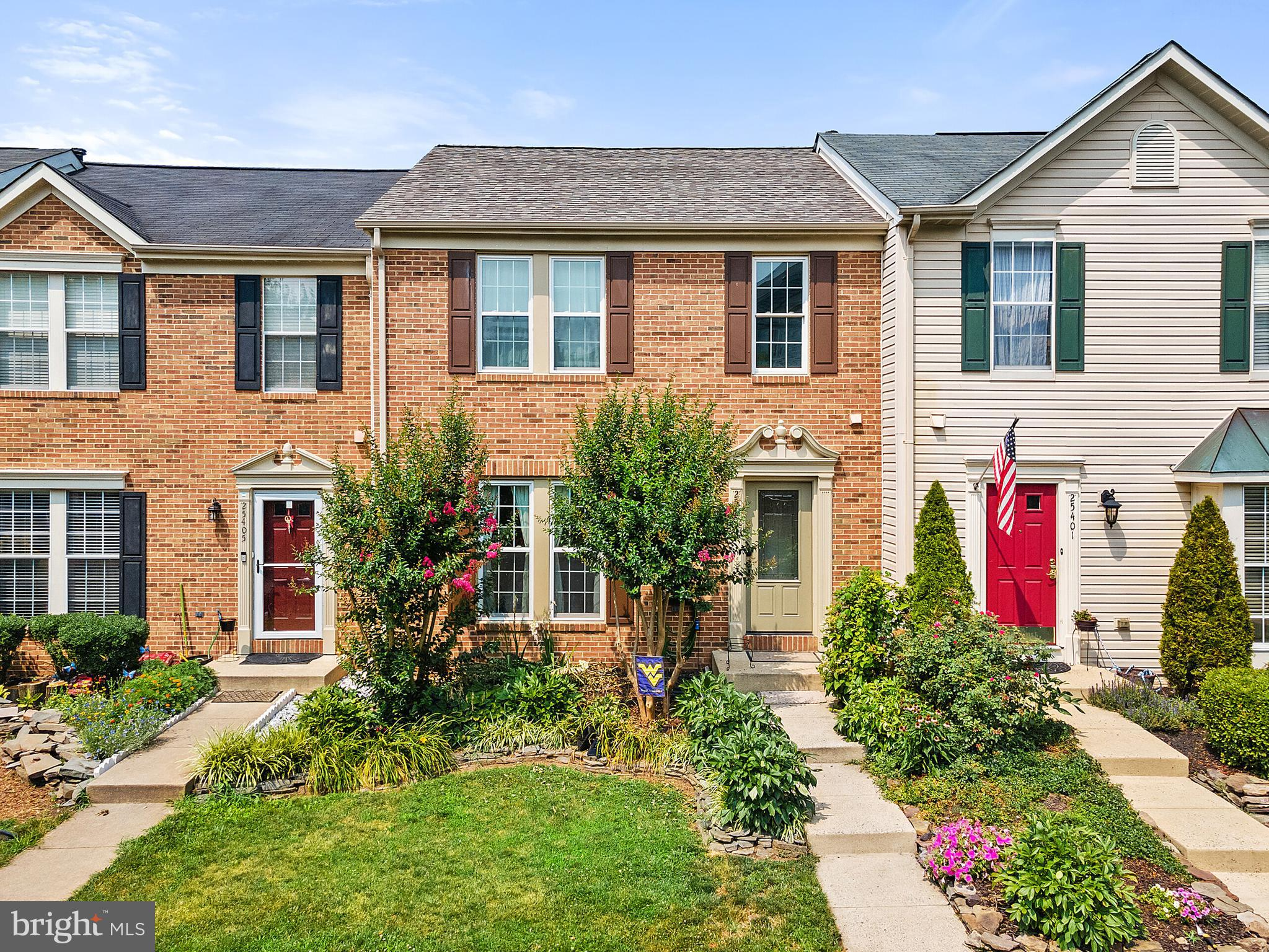Fantastic opportunity to live in South Riding in this beautifully maintained  3 level town home. The outdoor landscaping and flower beds welcome you in. Enjoy grilling and evenings on your new trex deck!  New carpet throughout!  This unit has a 3 ft bump out on main and lower levels.  There are 3 bedrooms upstairs and a full finished lower level with den plus laundry room and huge recreation room.  Walks out level to the patio.  Enjoy all of the amenities South Riding has to offer including 4 outdoor swimming pools, tennis courts, parks, tot lots, walking trails, 17 ponds, stage for outdoor concerts, movie screen for outdoor shows, activity and meeting rooms and so much more! This home is well located and has quick access to Route 50 and just 15 minutes to Dulles Airport. Washington DC is about 30 miles.  Love where you live! Offers will be reviewed on Monday 8/9 at noon!