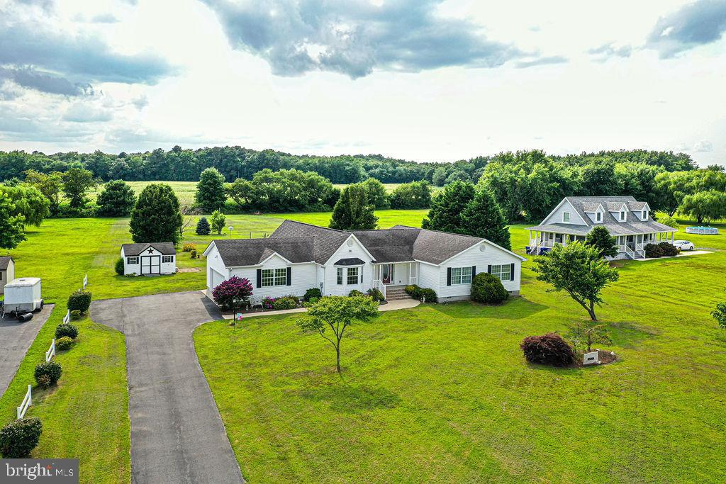 Welcome to 37100 Hudson Road! Situated on 1.75 acres just west of Fenwick Island, this well maintain
