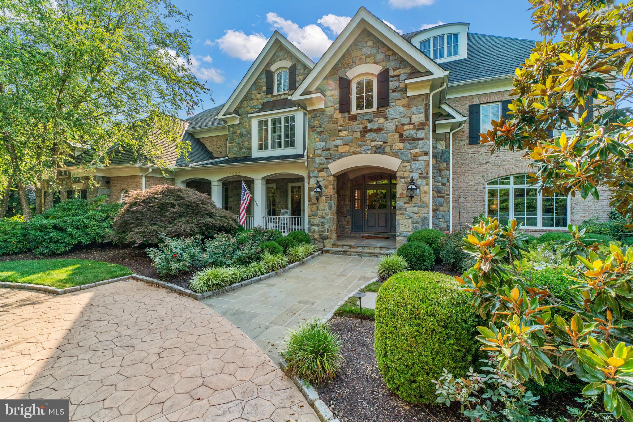 Langley Farms! Elegant gated and fenced home on 1.25 acres of lush,  private, and optimal living,  w
