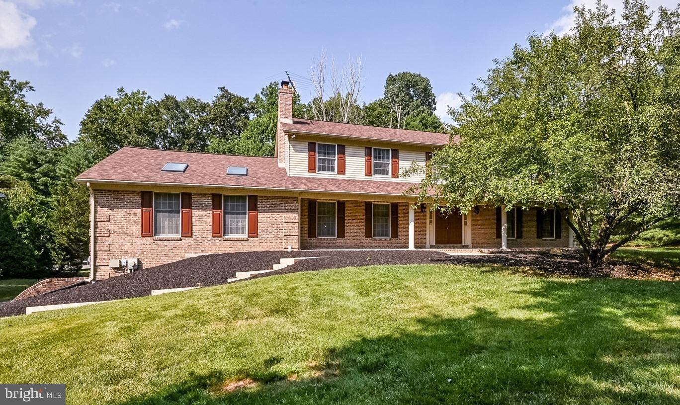 Welcome to a lovely home situated on almost a full acre in Hockessin.  Step into the large tile foye