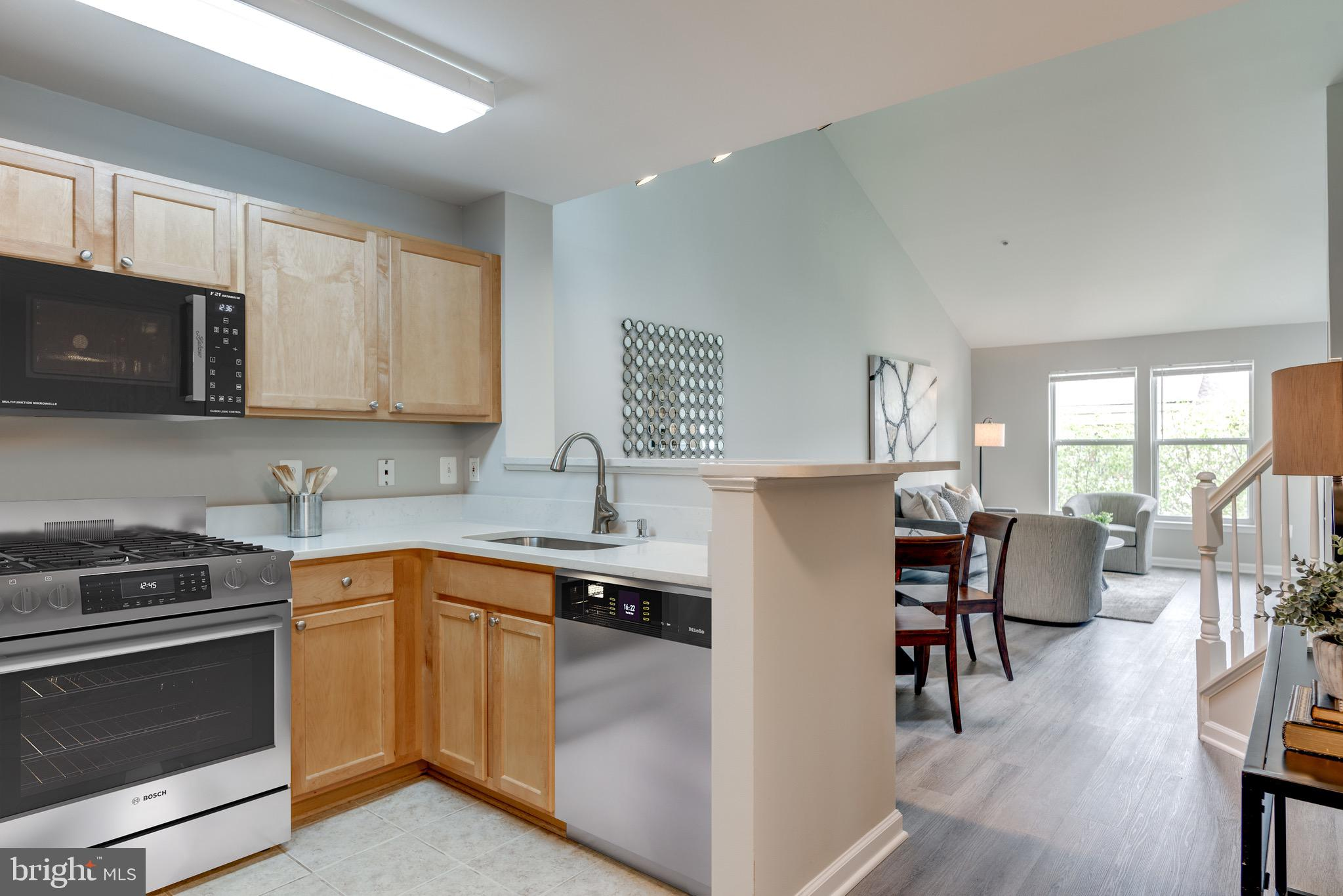 Must See Property in the Reston Town Center!!  [PLEASE NOTE: STAINLESS STEEL APPLIANCES HAVE BEEN ORDERED/PAID FOR AND WILL BE DELIVERED BY EARLY AUGUST] This tastefully renovated 1BR + den condo is quite spacious and offers lots of natural light. Featuring NEW quartz countertops in the kitchen & bath, NEW LVP flooring in living areas, NEW tile in bathroom, NEW carpet in the bedroom, NEW stainless steel appliances, NEW washer/ dryer, NEW water heater, NEW HVAC & a fresh coat of paint throughout.  This property has it all.  In addition to the covered deck for a comfortable outdoor experience, the condo has a spacious upper level that can be used for an office, tv room or even a guest room.  The location is superb being in the Reston Town Center with dozens of shops, restaurants, CVS and more.  Very close to the future metro rail station.  This won't last long!