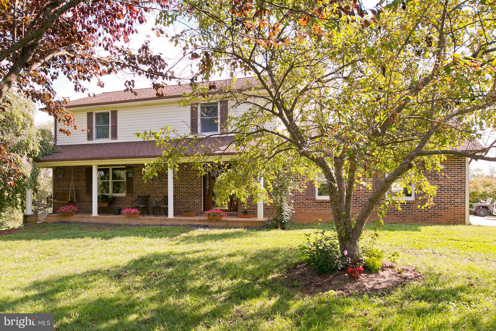 This lovely 3-bedroom, 2.5 bath Colonial is situated on 5+ acres in the country, but convenient to Route 55, I-81/I-66.  The front, back and side yards provide ample room for any, and all, outdoor gatherings.   No HOA. The owners have made significant improvements and upgrades since 2012.  There is a detached 26' x 29' garage, and a huge 30' x 60' garage/workshop with electricity and a wood burning heat source.  If you're looking for a place to store your boat, jet skis, or you're a car enthusiast who likes to work on cars, there's room here!  Sit in the gazebo or on the deck with your morning coffee and watch the sunrise.  You may even see some deer coming out of the lush tree line that borders the property.