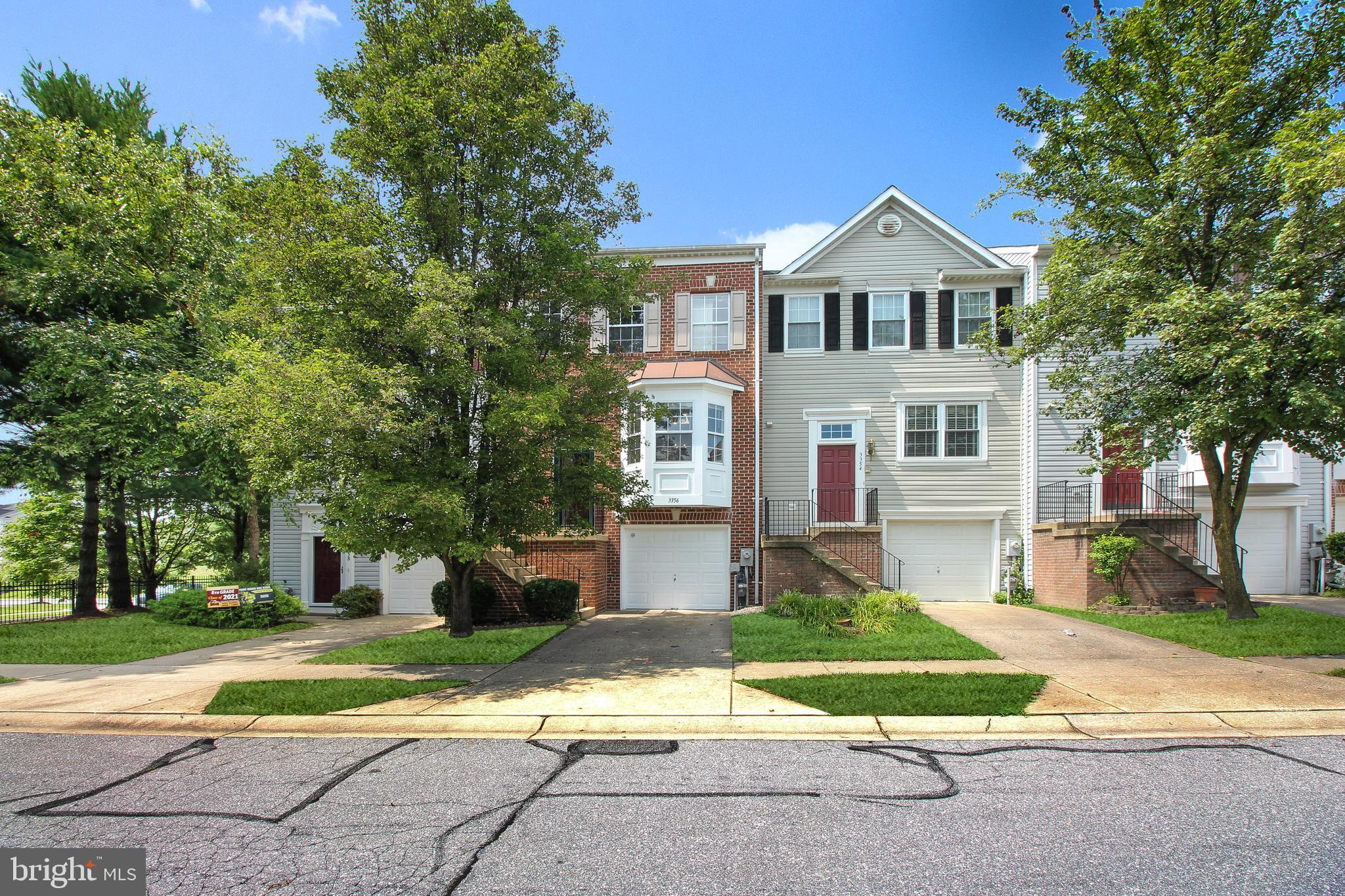 Magnificent 3 finished level townhome with tons of updated with a garage in Howard's Ridge. Brick fr