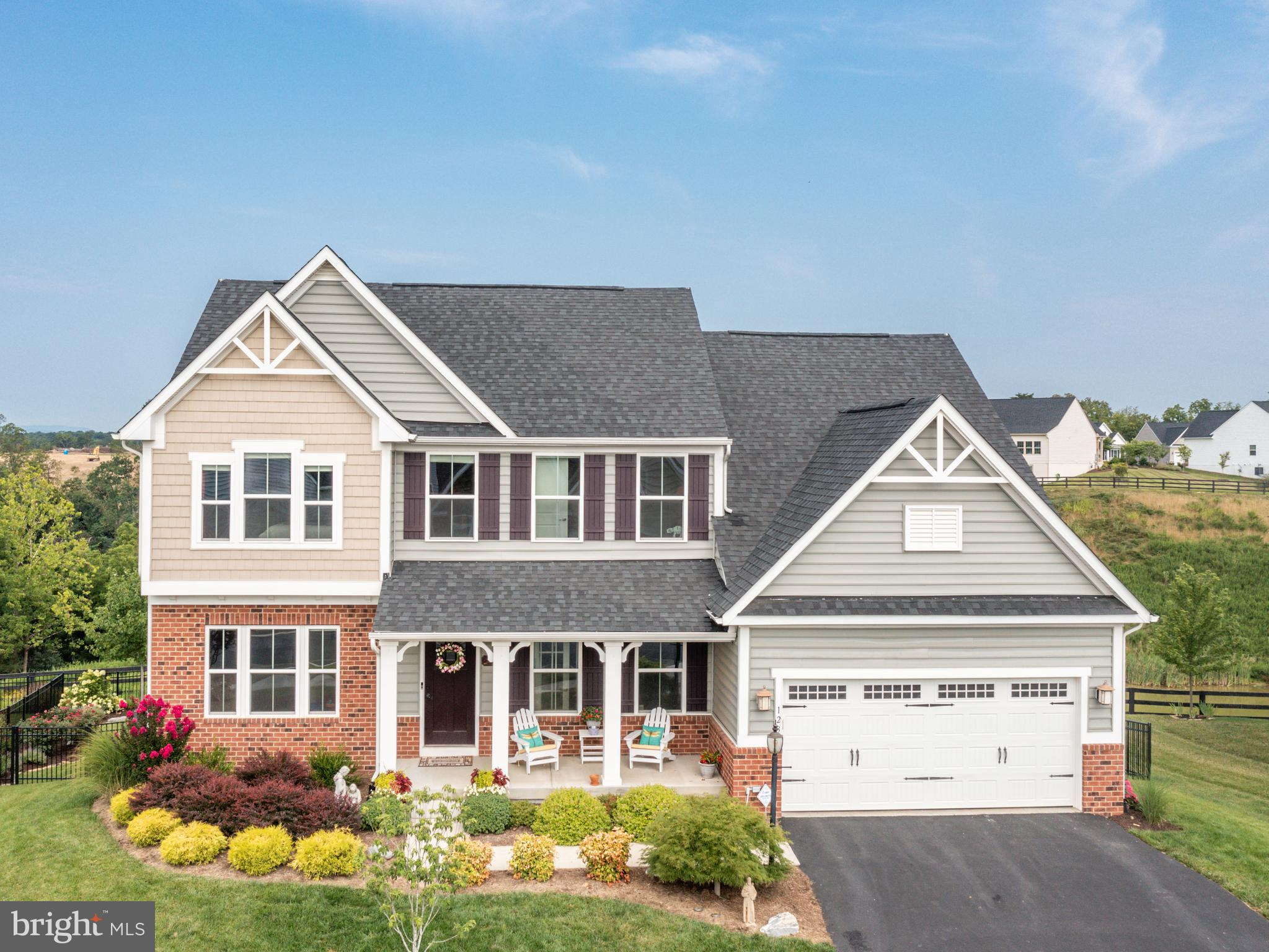 In the gated Lake Frederick  planned community sits this  5 bedroom 4 bath -Ryan homes Revanna Model