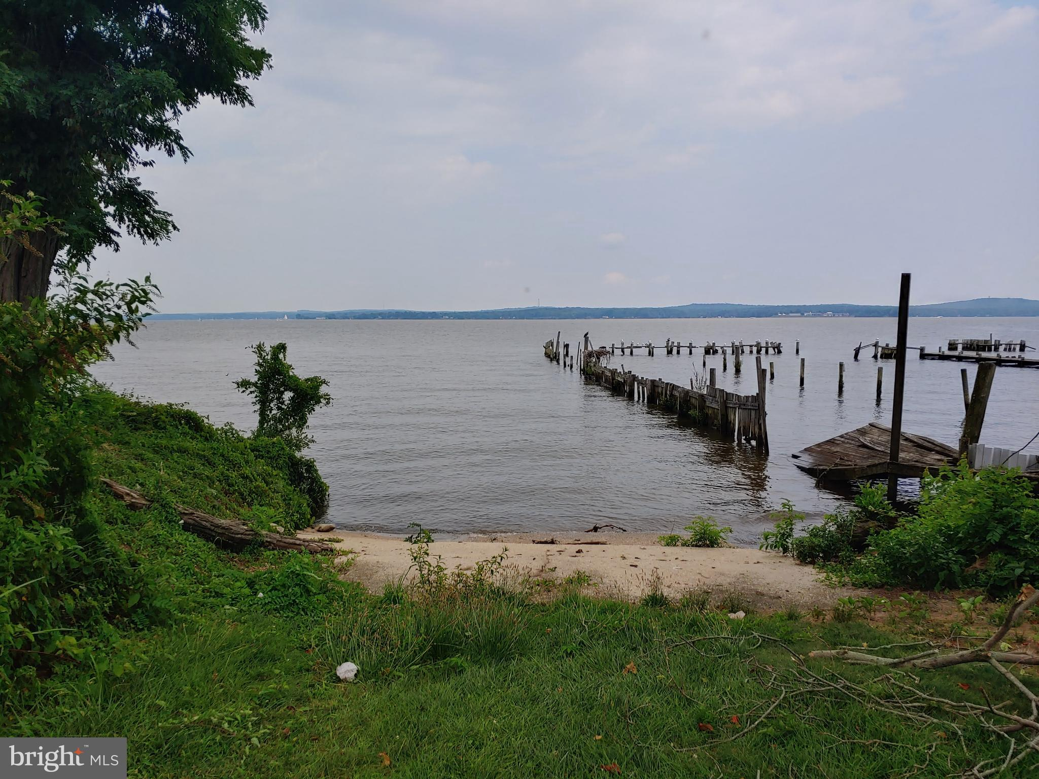 Terrific sunrises over your own waterfront!  Town water and sewer with  this diamond in the rough co