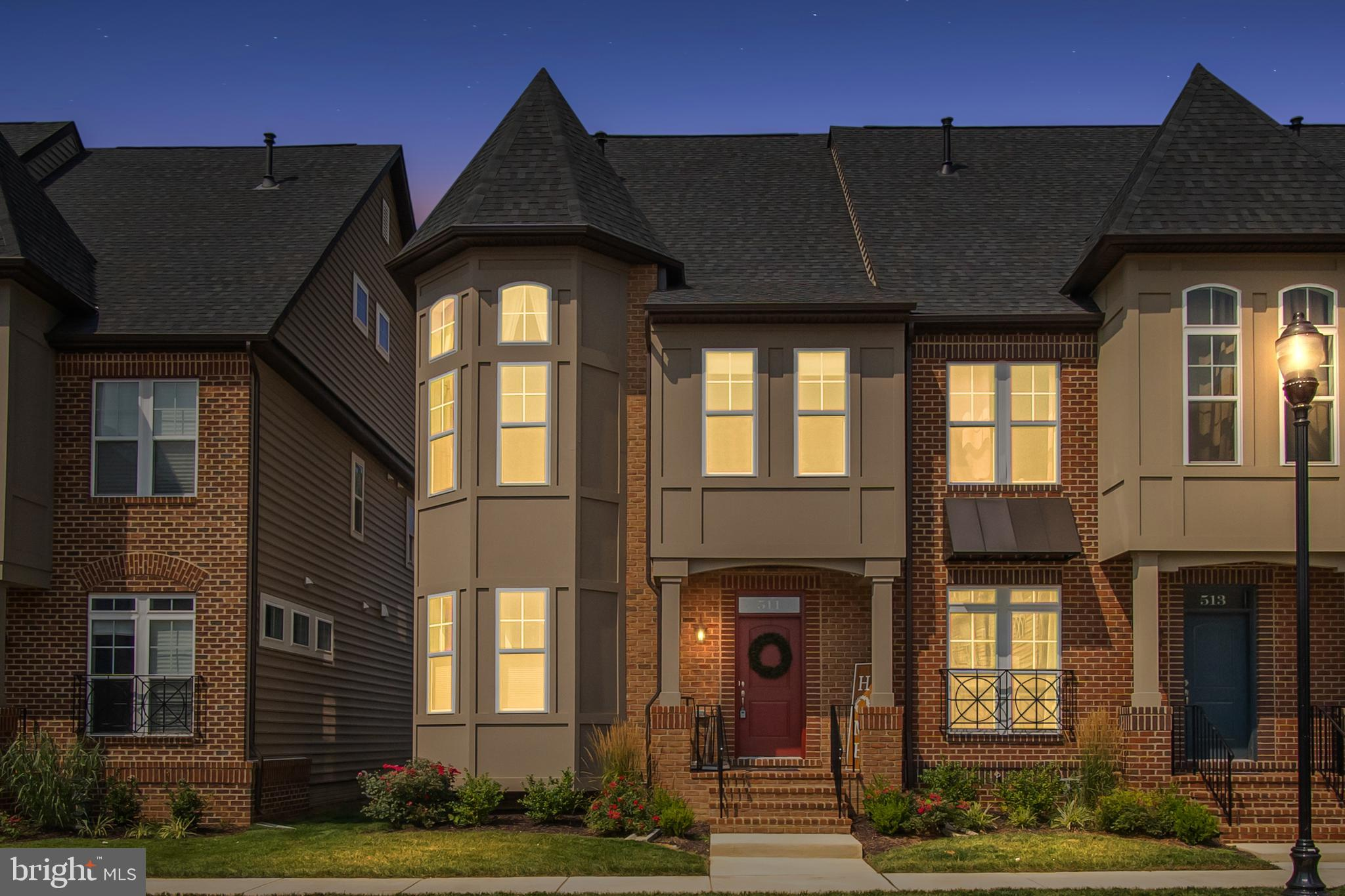 Luxury End Unit Townhome with Rooftop Deck! Walk into your spacious foyer with luxury laminate floor