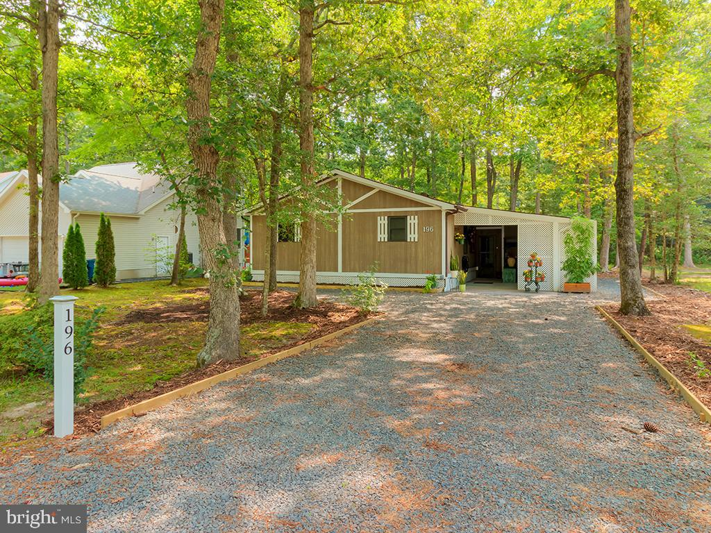 Coastal retreat on a partially-wooded site in Ocean Pines offers tranquility just minutes from the b
