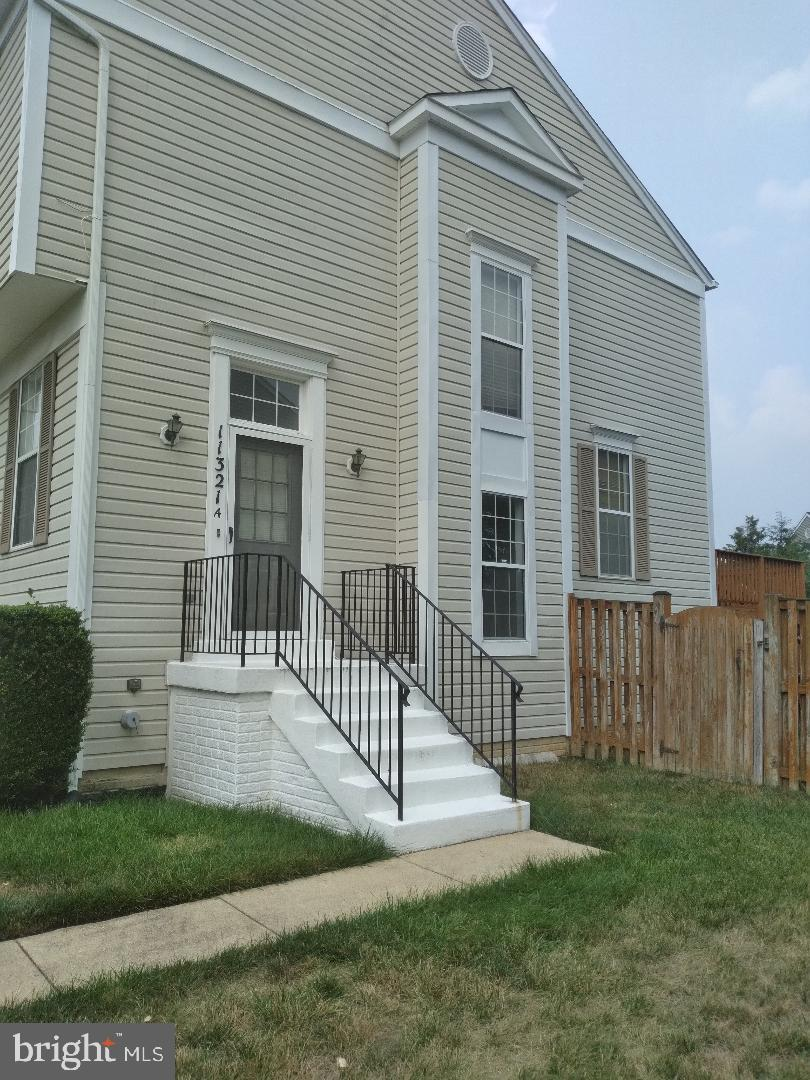 This Townhouse shows with furniture, but it is vacant.  It is a large townhouse with 4 bedrooms with full baths on each floor with tubs.  Fenced 8 foot back yard with deck off  kitchen.  Beautiful shed in back yard.  Freshly painted  walls & steamed carpet.  Fence was painted this weekend.