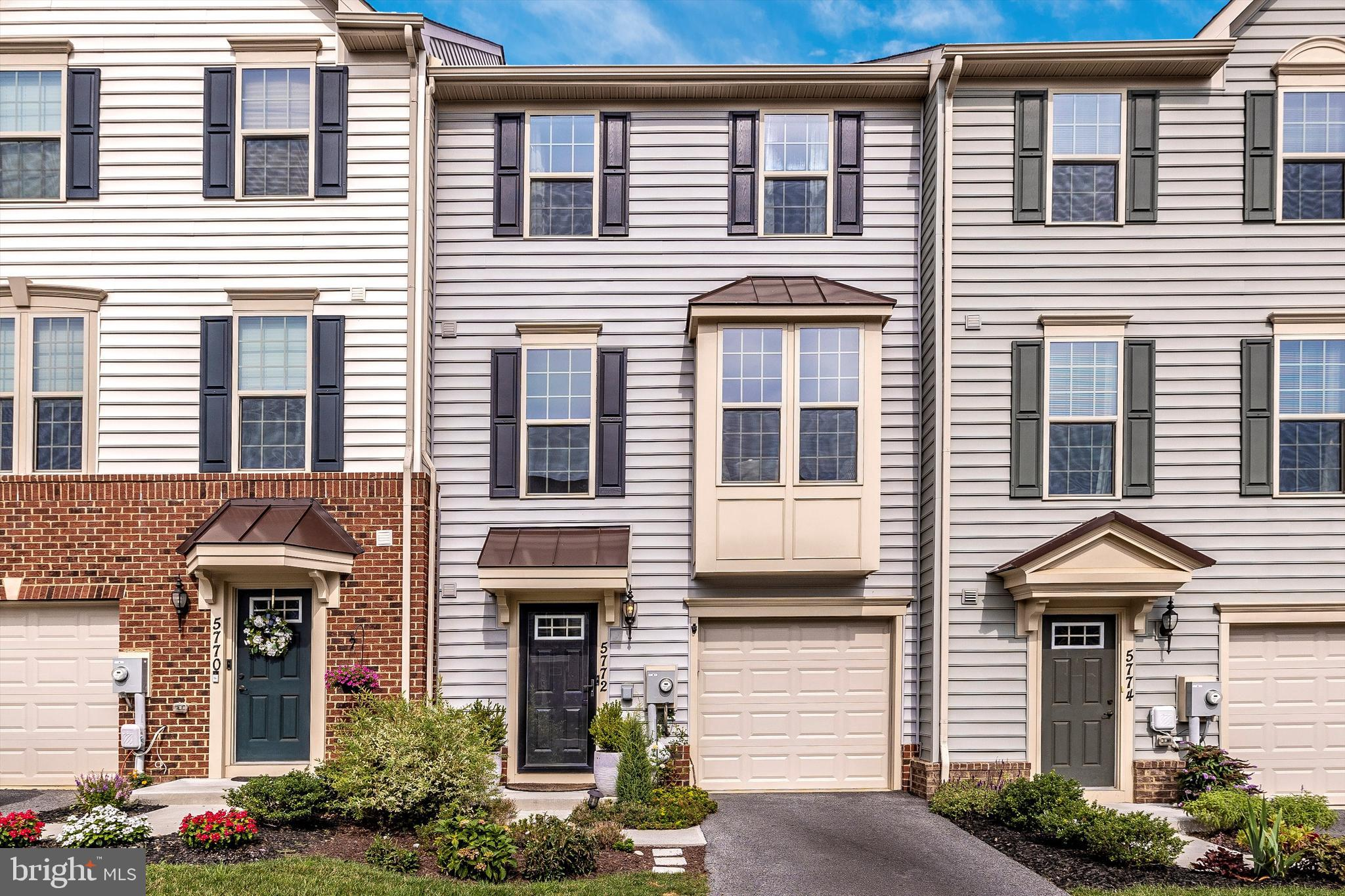 Beautiful townhome,  4 years young  with many upgrades.  Bright and open unit.  Main level entry wit