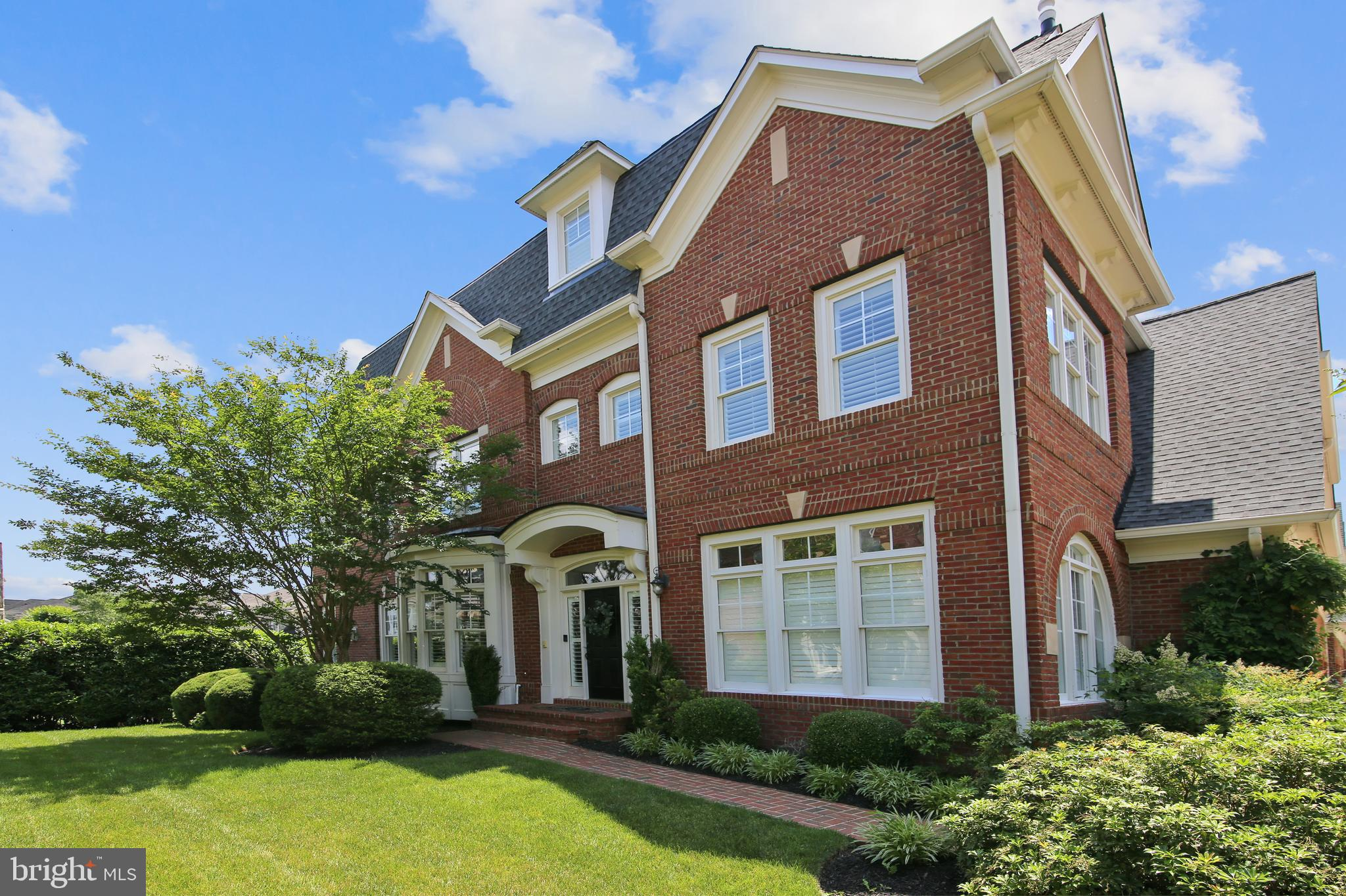 End unit brick Michael Harris Townhouse in the gated and guarded golf course community of River Cree