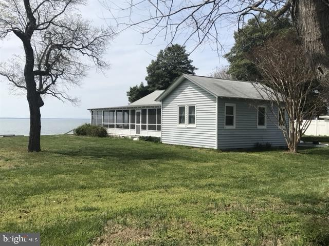 Remarkable sunsets on this 2 Bedroom home with wrap around porch.  Beautiful lot that hosts a large