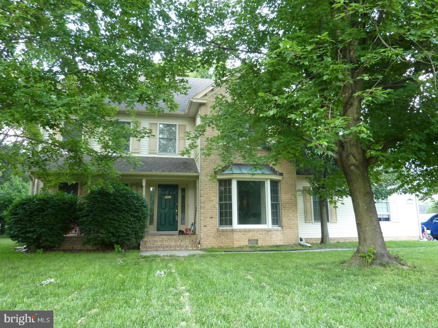 Beautiful and spacious 4 bedroom 3.5 bath Colonial in Centennial Village. On the main level, there I