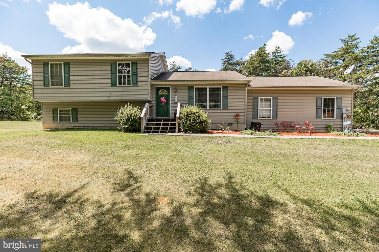 Peaceful and tranquil surroundings is what you will find in this charming home nestled in the woods.