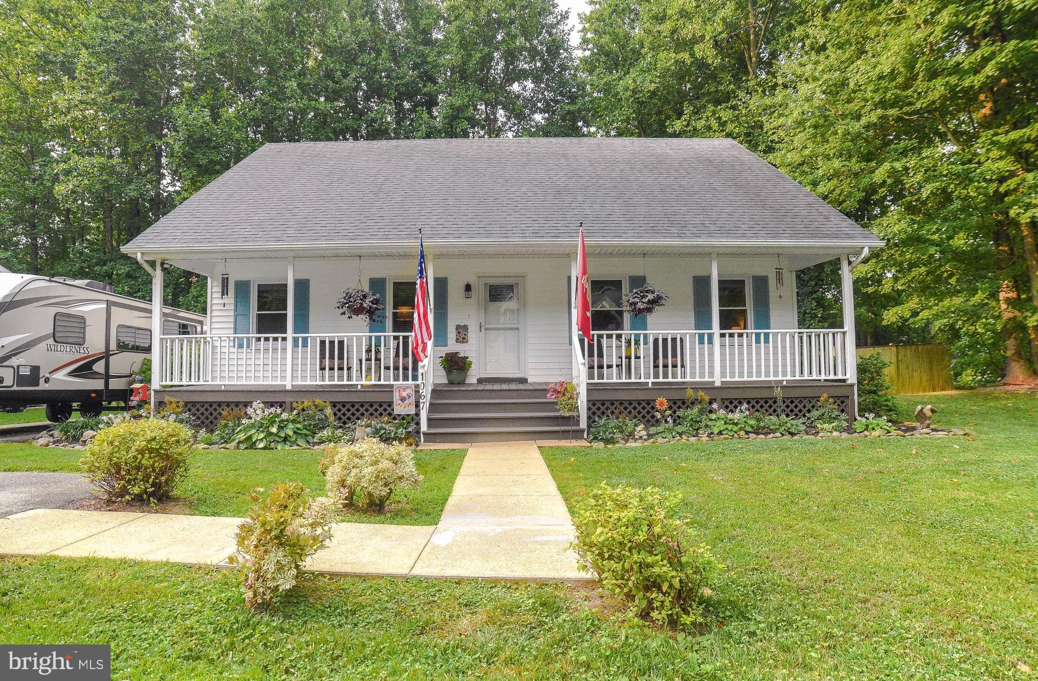 Charming Cape cod on HUGE half-acre, FLAT, corner lot with fenced yard!  This home has been meticulo