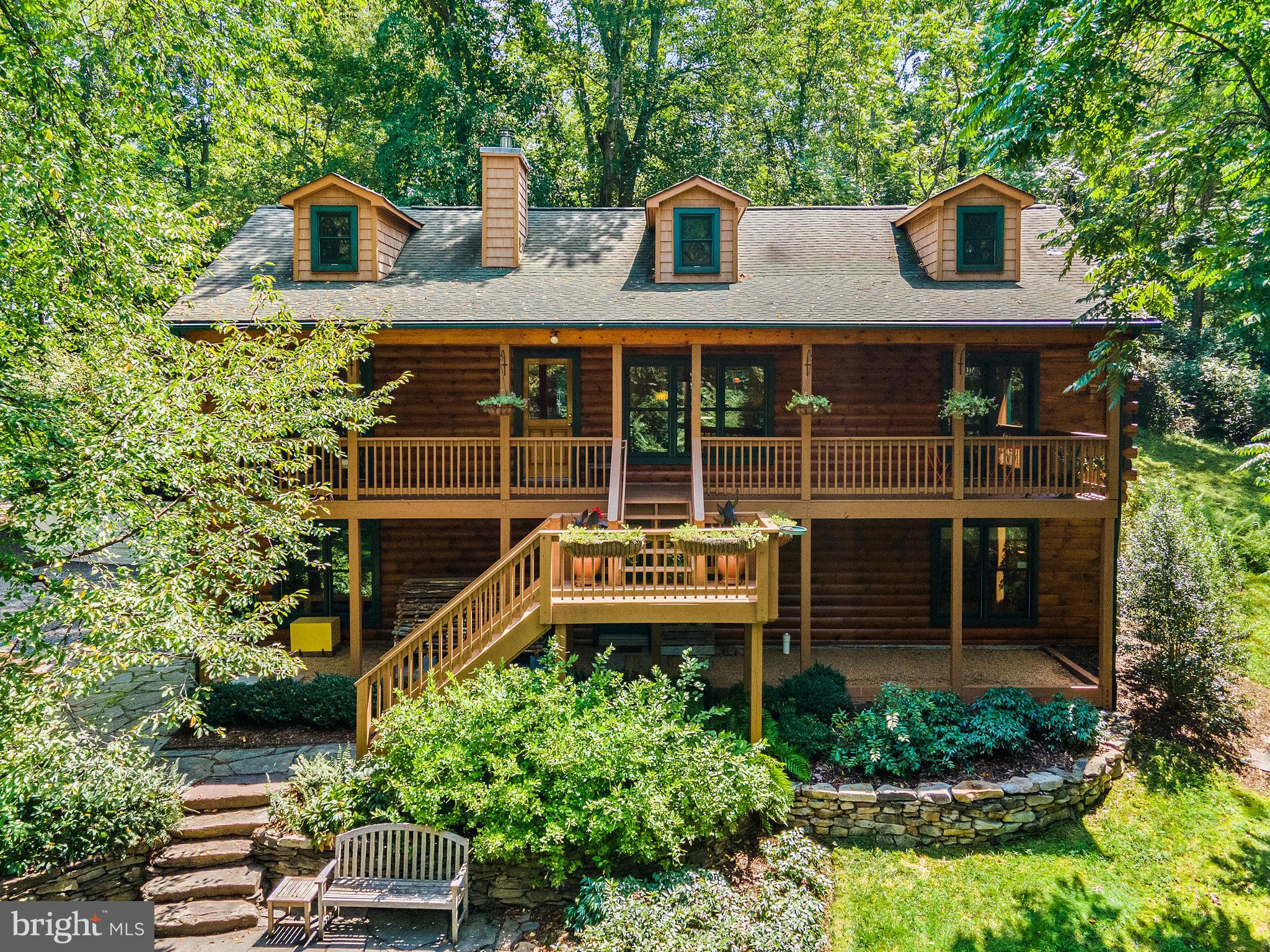 Custom log home  built in 2001 on 8+ Acres available in coveted Delaplane, Virginia. Enjoy end-of-the-road privacy and tranquility with the convenience of being within minutes of Historic Main Street, Marshall, VA and several wineries.  This home offers an Owner's suite, three additional bedrooms and three full bathrooms. Open concept great room and kitchen combination with cathedral ceilings. The main level porch awaits as you enjoy the view of the professionally designed with pollinators in mind and installed landscaping with drip irrigation system.  Additionally thoughtful features: High Speed Cellular Internet through T-Mobile 4G LTE (5G is on its way); Fenced animal proof 20' x 20' garden; Whole-House Surge Protector (Renewable, meaning it has modules that can be replaced if they fail - cheap systems aren't like this); Garage/Shop with extensive lighting and many additional electrical circuits; Kinetico Water Neutralizer & Softener Systems; Rinnai tankless water heater; New Stainless Steel kitchen appliances; New Carpet Throughout; Fresh Paint Basement Level;  RSF Zero-Clearance Fireplace, 5-6 cord of wood from your own property heats the house all winter; Logs stained last year; Driveway graded & graveled this year; Spectacular Blue Ridge Views in Winter.