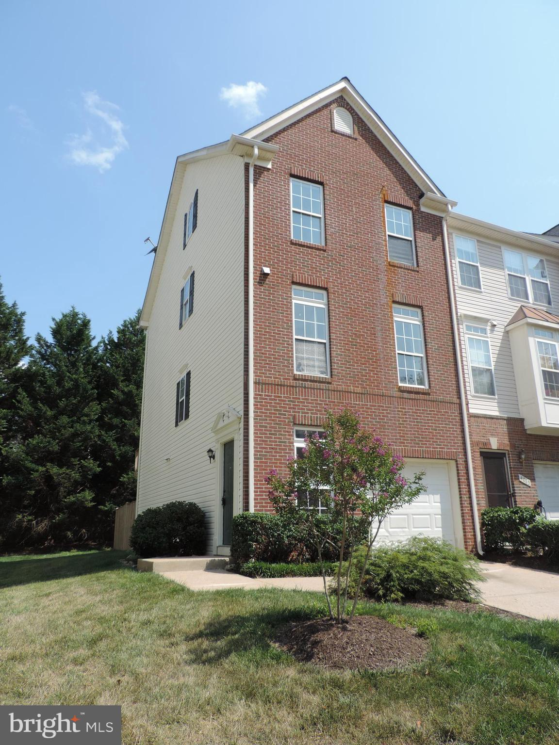 HUGE PRICE REDUCTION! RARE 4 Level Brick Front End Unit Townhouse with 3 Primary Bedrooms w/ Full Ba