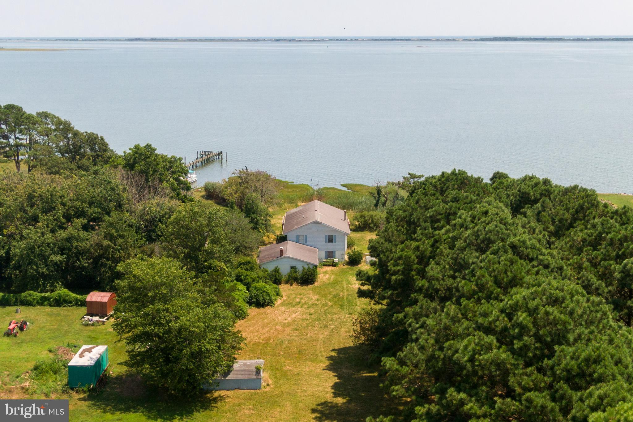 This Direct Bayfront three bedroom three bath Home sits on 1.96 acres overlooking the Sinepuxent Bay