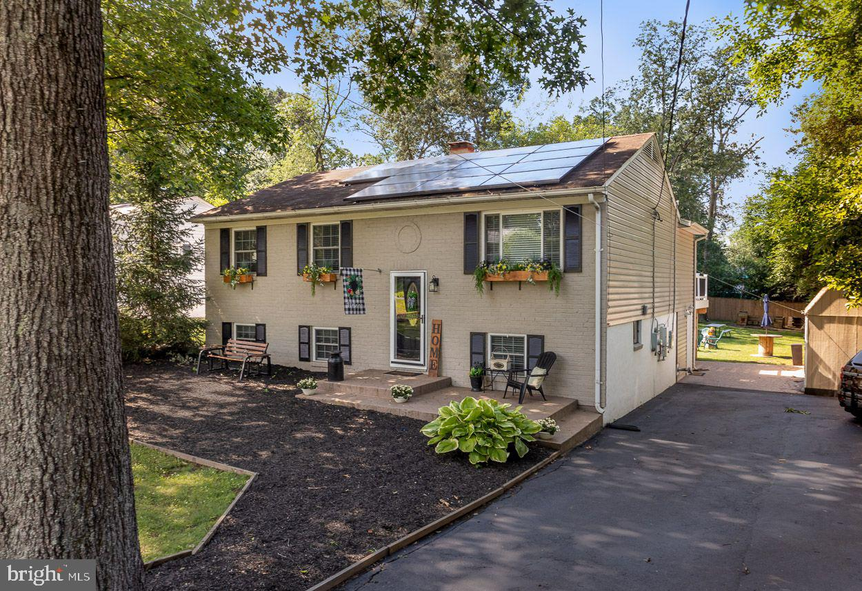 """What a Great Place to Call """"HOME!""""  This Very Attractive, Spacious, Split Foyer with Additions and a"""