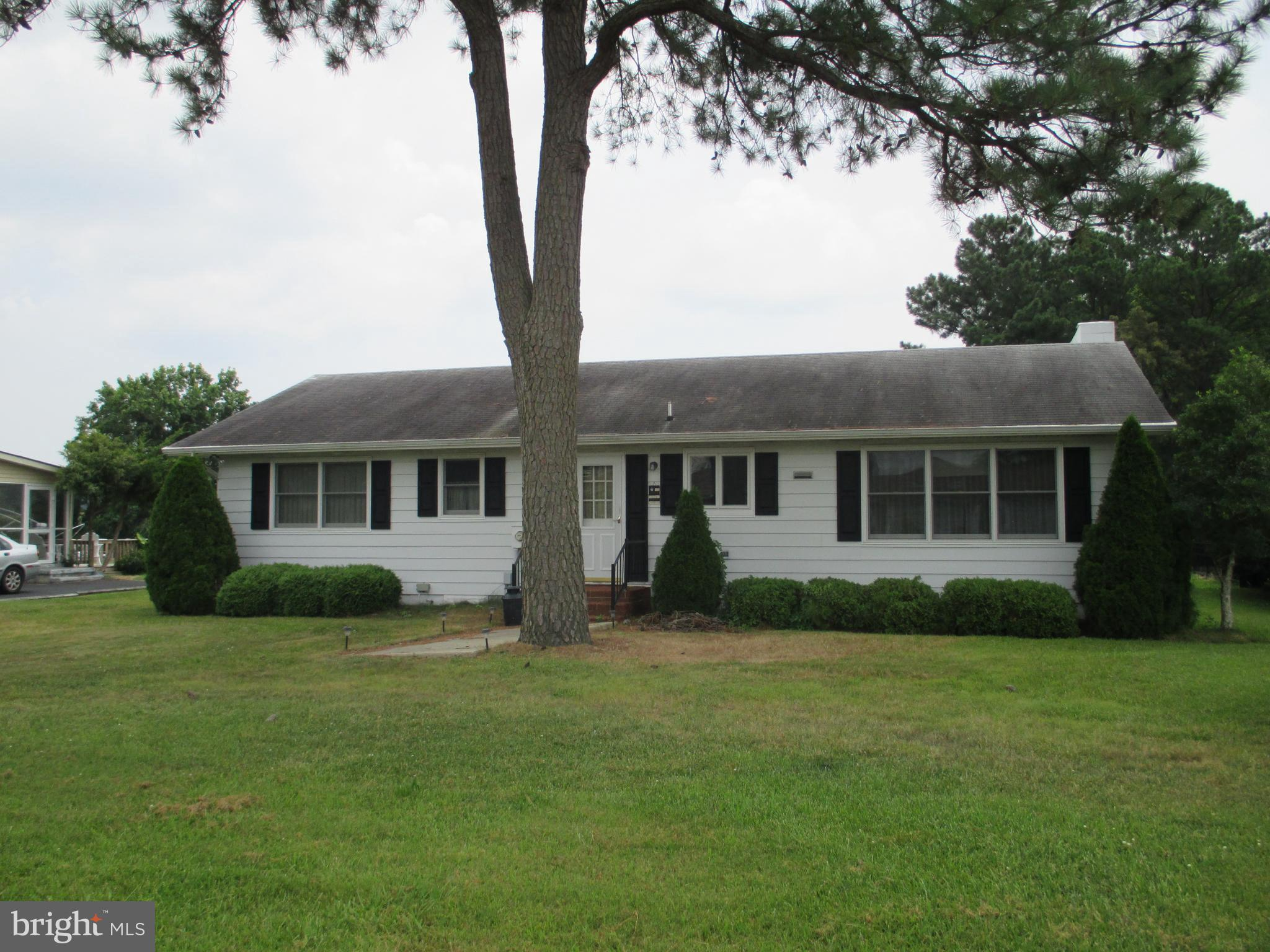 Original 1973 Ranch home on bulkheaded canal lot with step down dock, only 5 lots from open water, C