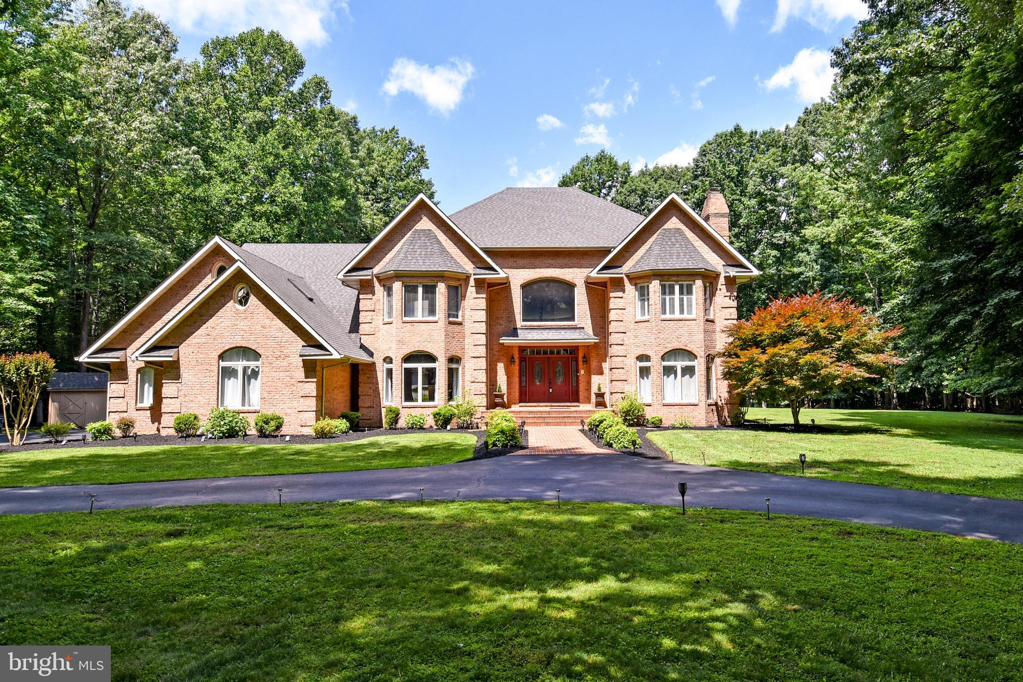 7865 Locust Place  is a  rare offering.  This all brick home in Port Tobacco, MD is approximately 35