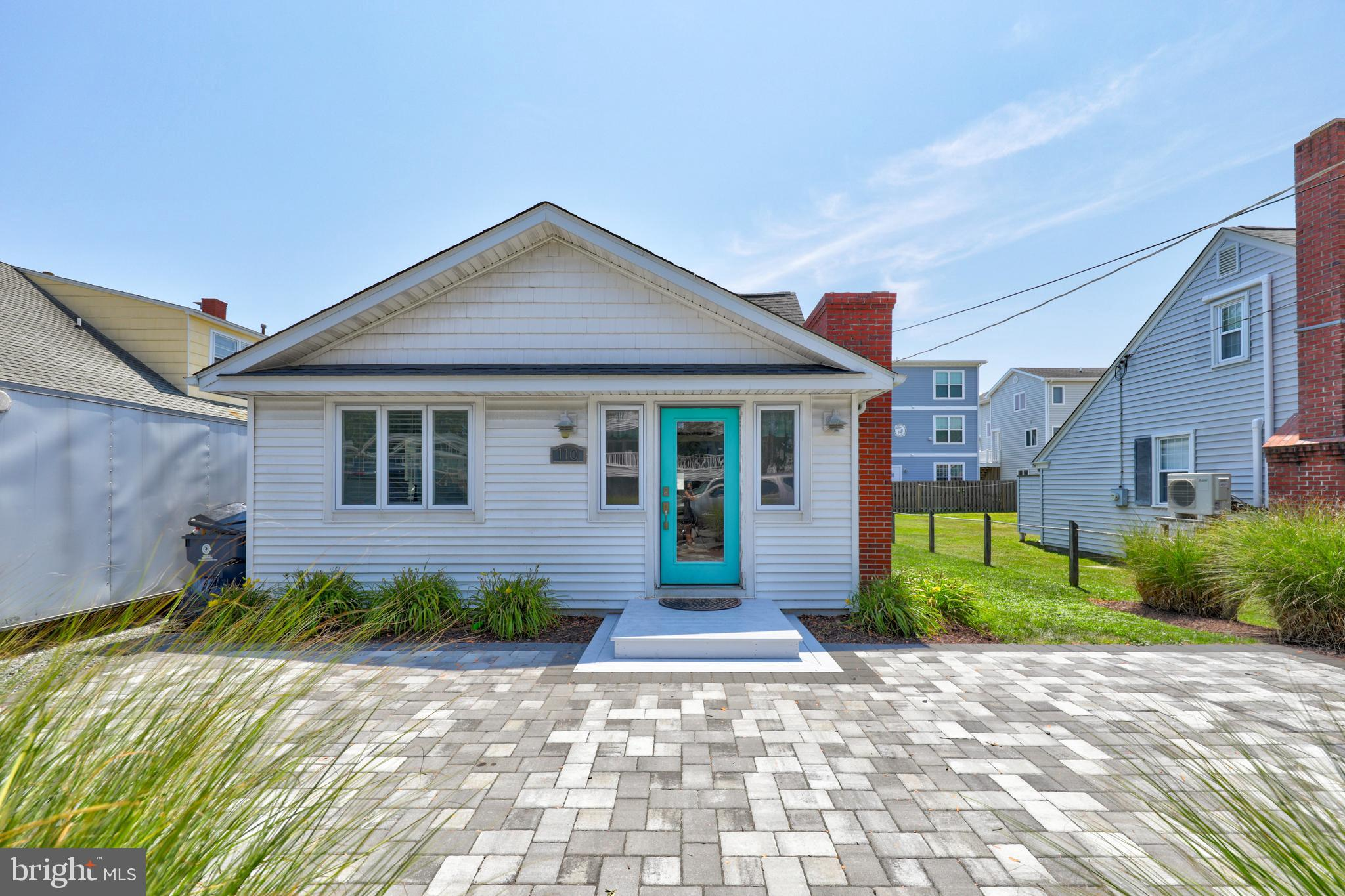 COASTAL. DOWNTOWN. INVESTMENT MACHINE. Relaxing is easy in this chic and updated 5 bedroom, 3 bath c