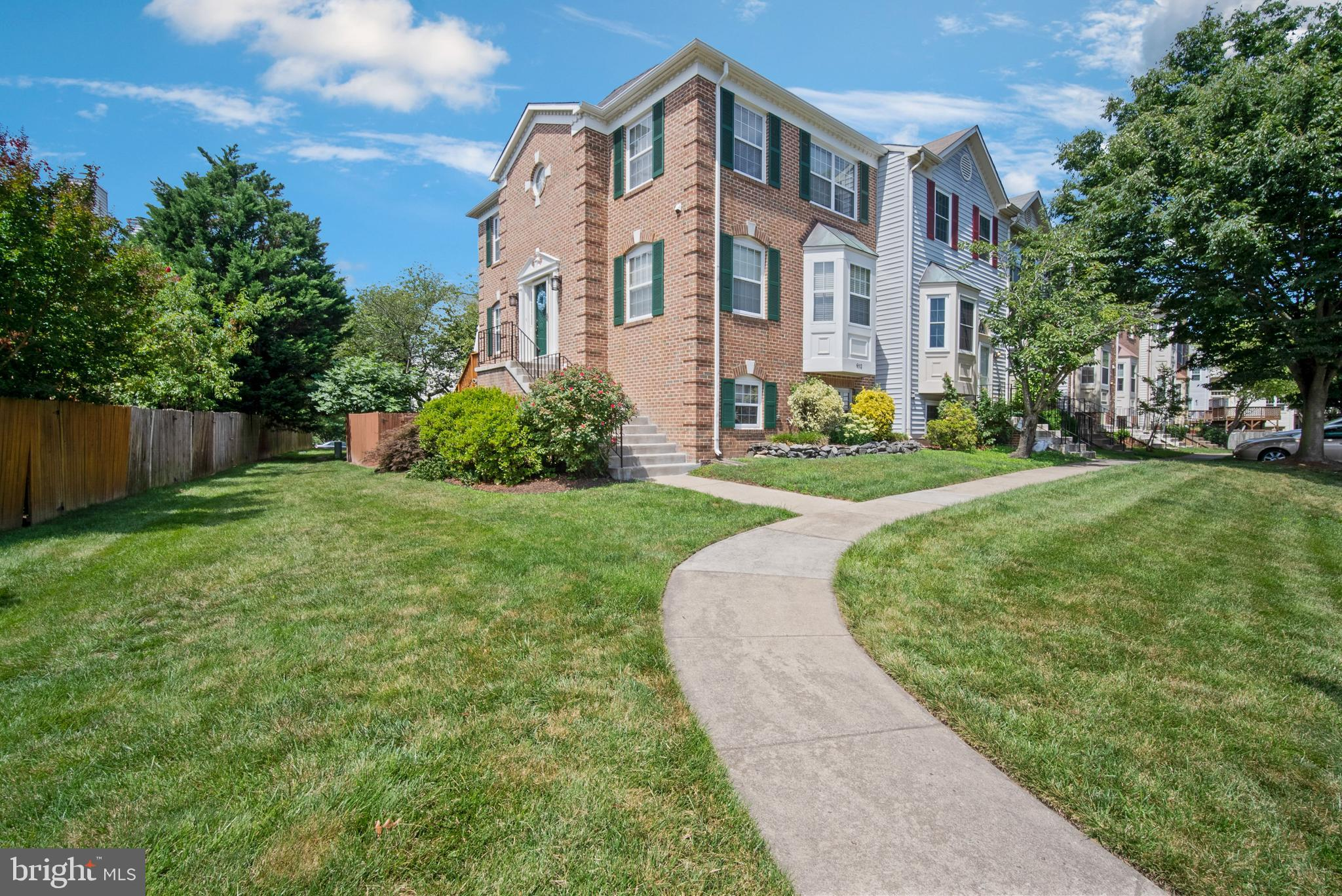 Best home at the best price! Beautiful and spacious end unit brick townhouse with hardwood floors th