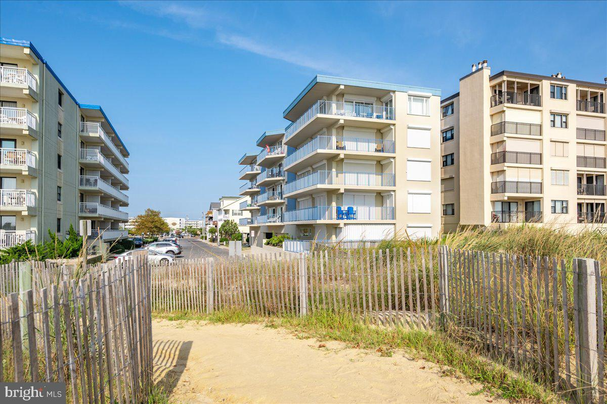 Turnkey 2-bedroom 2-bathroom fully renovated condo with amazing Ocean Views!  Located in mid-town  Ocean City in the recently updated Blue Sea Colony building.  Units rarely come for sale in this 13-unit, mid-town condominium. Situated just one unit back from the oceanfront with an extra large balcony and wonderful southern exposure. You will love the unique floor plan featuring an open concept with bedrooms on opposite sides of the unit, each with completely remodeled en suite baths.  Recent improvements include new kitchen cabinetry, granite countertops, appliances, tile backsplash, and beautiful waterproof flooring.  Fabulous coastal decor featuring beadboard, shiplap, and new santa fe style doors. Impeccably maintained  and being sold fully furnished. Very well run association with reasonable condo fees.  In the last 7 years they have refurbished the elevator, painted the entire exterior, refinished decks/railings, and replaced all carpeting in hallways. On-site parking and deeded storage closet.  This is the one you have been waiting for! The perfect second home at the beach and an excellent investment property.