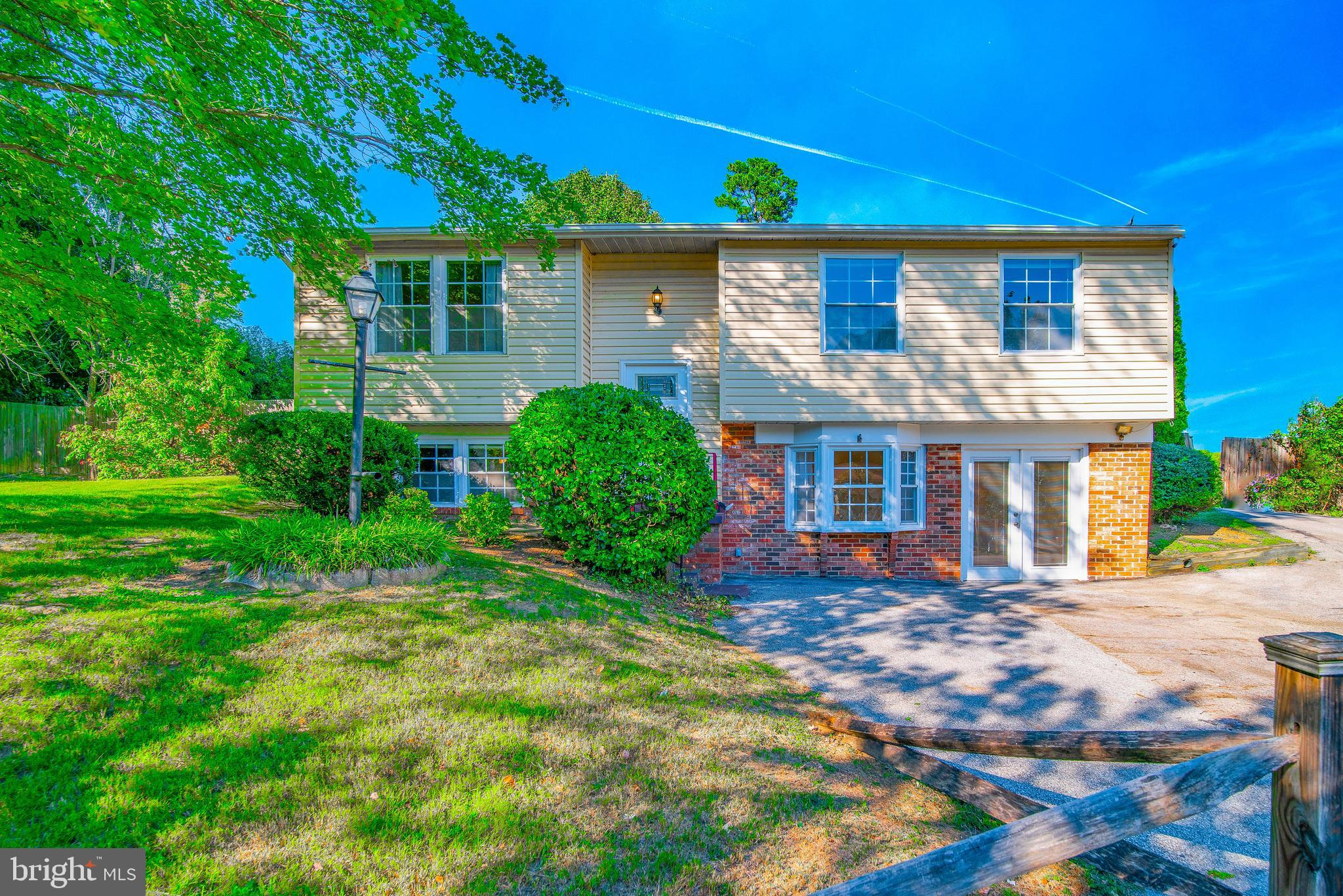 Spacious home tucked in on a small court.  Large half acre  fully fenced private back yard, with an