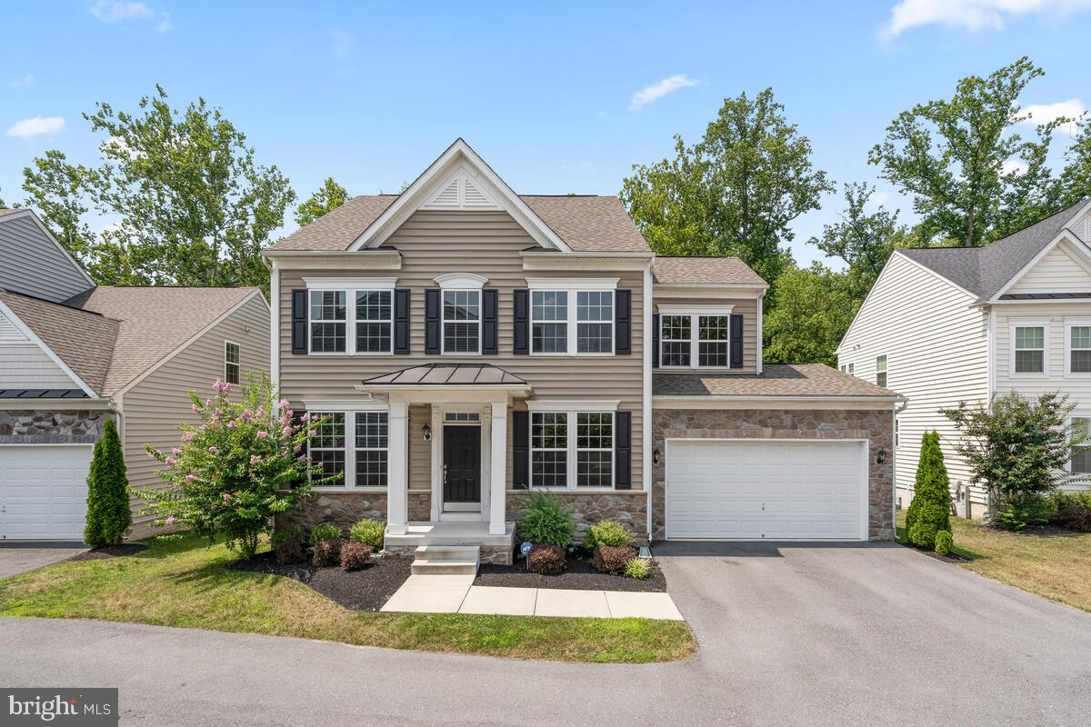Pristine three-level Colonial in the lovely  Guilford Overlook community.  Built in 2016, the home o