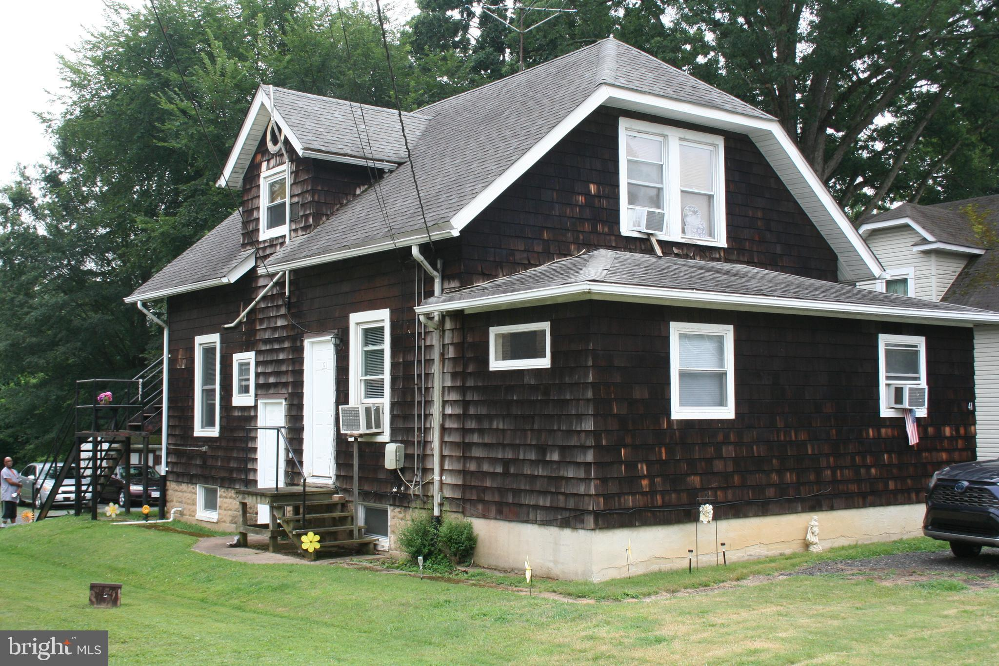 Great investment opportunity! This detached house contains three rental units. Each consisting of li