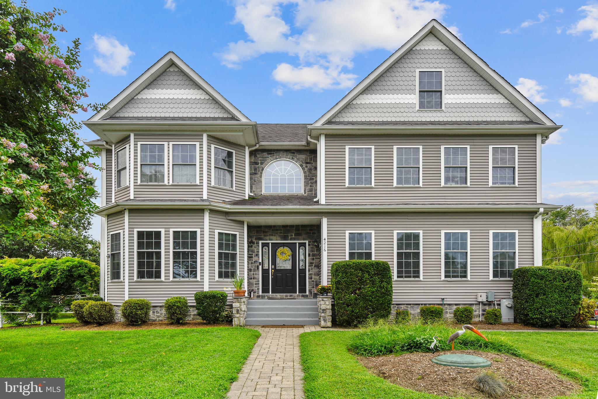 Beautiful, spacious custom-built water view home in the sought-after neighborhood of Saunders Point. This house has four amazing finished levels with tons of charm and detail situated between the Chesapeake Bay, Triton Beach Park, and Mayo Beach Park all within walking distance. The main level has hardwood floors throughout; a large open kitchen with granite countertops with plenty of counter space. The kitchen includes an eat-in area, seating at the island, and a large space for family dining all open to the family room with a cozy fireplace. Also on the first floor, spacious den/office/homework room. The second floor has a large master bedroom filled with natural light, including a spa-like bathroom with bidet; double vanity/sinks; whirlpool bathtub; five heads, double walk-in shower. There are 3 ample-sized bedrooms each with walk-in closets on the second floor as well, sharing a full bath with a jacuzzi tub. Large laundry room with additional storage also on the same levels as bedrooms. The entire second level has all new hardwood flooring as well.  Head up to the third floor where your guest, au pair, or in-laws can relax in their private suite with a rec area and full bathroom. The basement has recreation space with a custom bar and plenty of room for storage recently updated paint and new carpets. This home affords you direct views of the Chesapeake Bay from all levels of the home. The rear and side yard have  a new maintenance free white picket fence.   Saunders Point offers the best of waterfront living, with close access to shopping, blue-ribbon schools, and DC/Baltimore/VA or Annapolis. Don't miss out on this one.