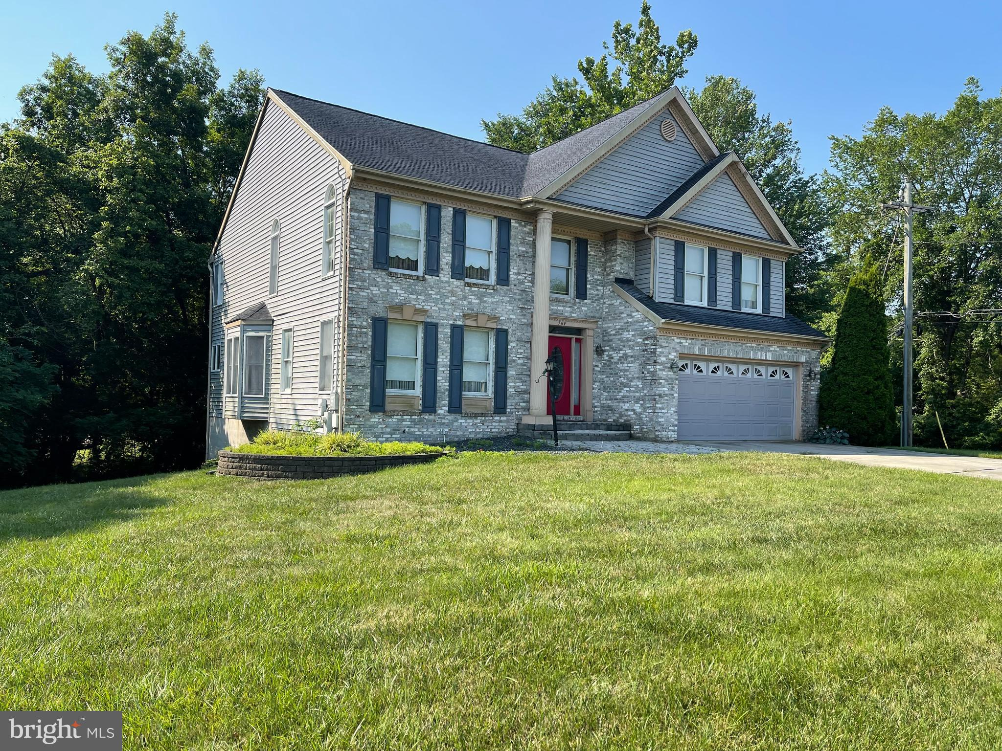 Spacious single family detached home offering over 3400sq of living space with four bedrooms, three