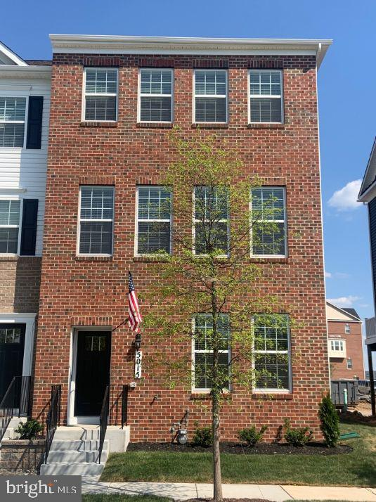 Just released! September delivery on this brand new end unit townhome with full brick front built by