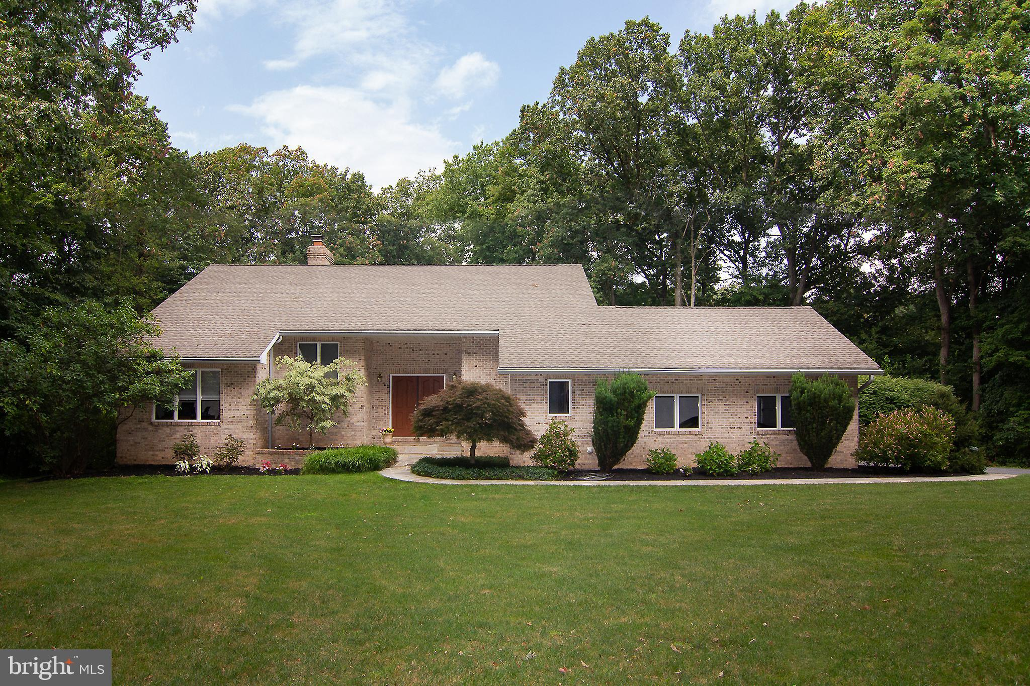 Enjoy this secluded brick contemporary home with beautiful mature landscaping.  Nestled on 2.74 acre