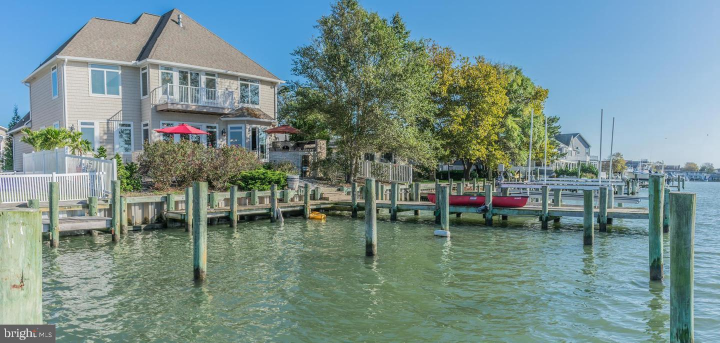 Natural light pours into this jaw dropping direct bayfront property with so many bells and whistles!