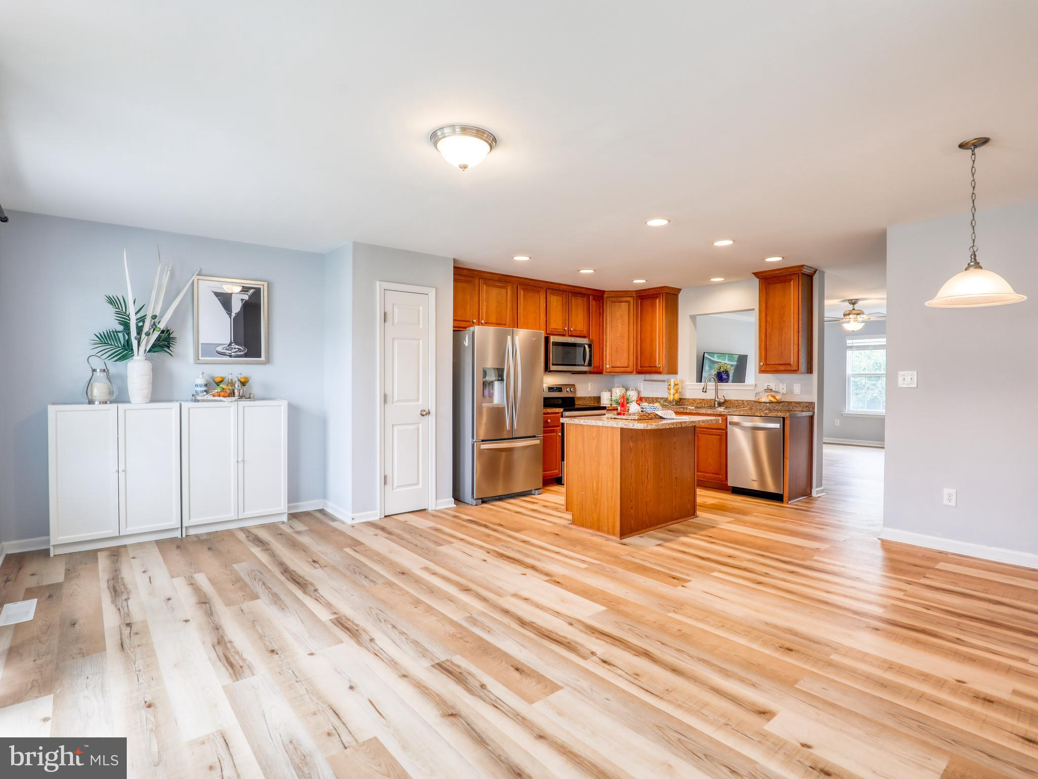 Brimming with updates and enhancements, this Fairfax Crossing townhome with attached garage is move-