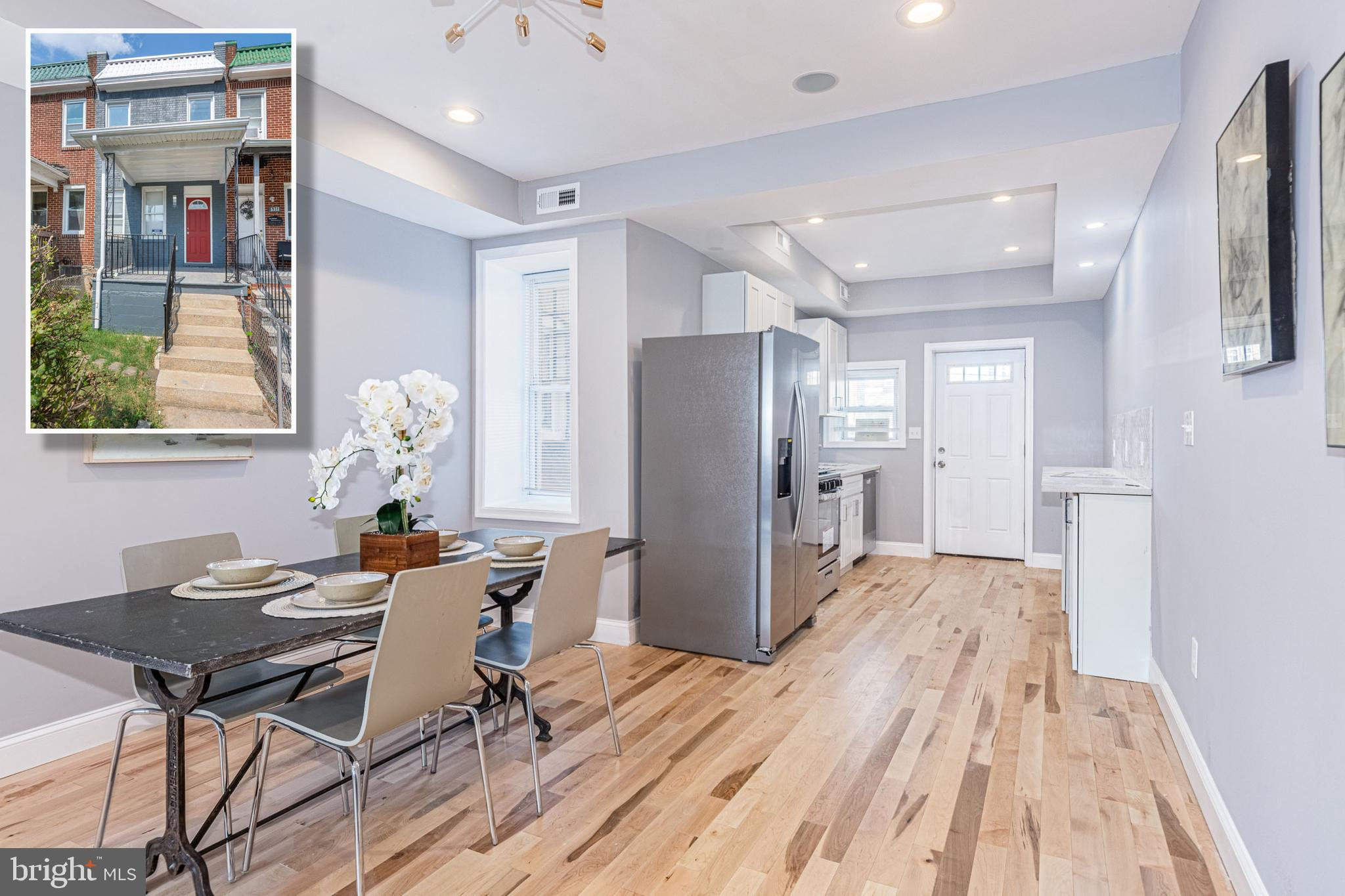 BEAUTIFULLY DESIGNED PORCH FRONT RENOVATION WITH 3 FINISHED LEVELS & OFF STREET PARKING!  Open floor