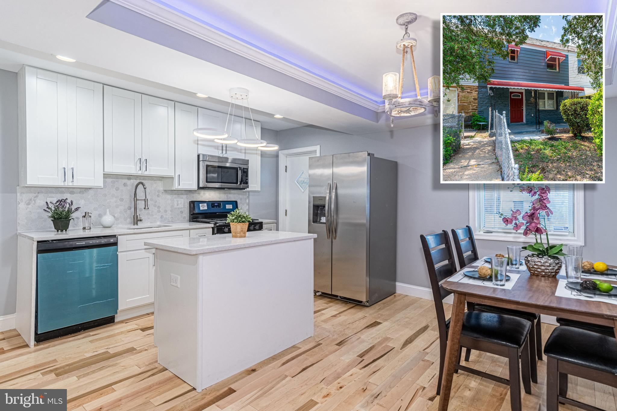 PICTURE PERFECT RENOVATION WITH 3 FINISHED LEVELS AND OFF STREET PARKING! Features include an open f